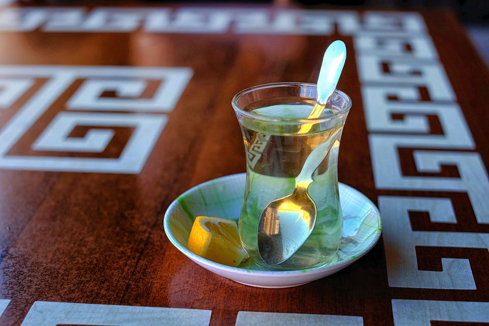 Sage tea served with a slice of lemon.