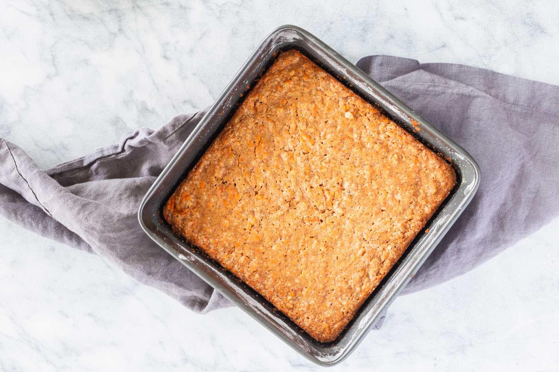 Bake carrot cake in oven