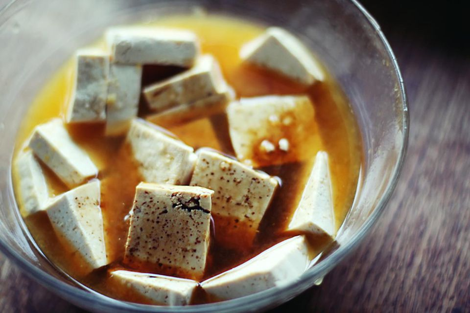 tofu marinating in a bowl