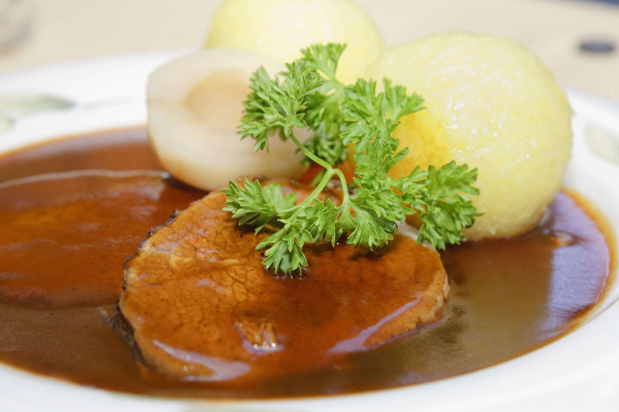 Sauerbraten, marinated beef, with dumplings