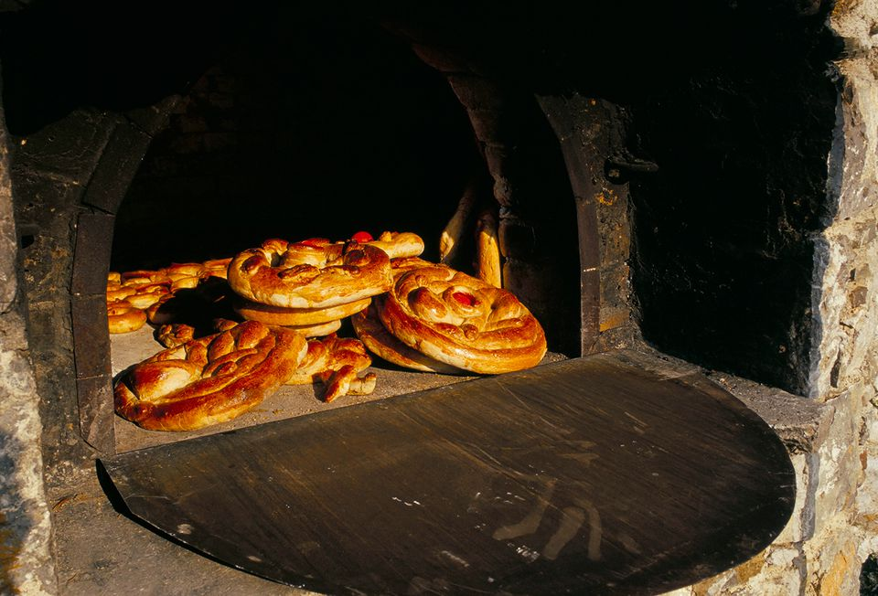 Eastern bread baked in outdoor communal oven, Olymbos (Olimbos), Karpathos, Dodecanese islands, Greece, Mediterranean,