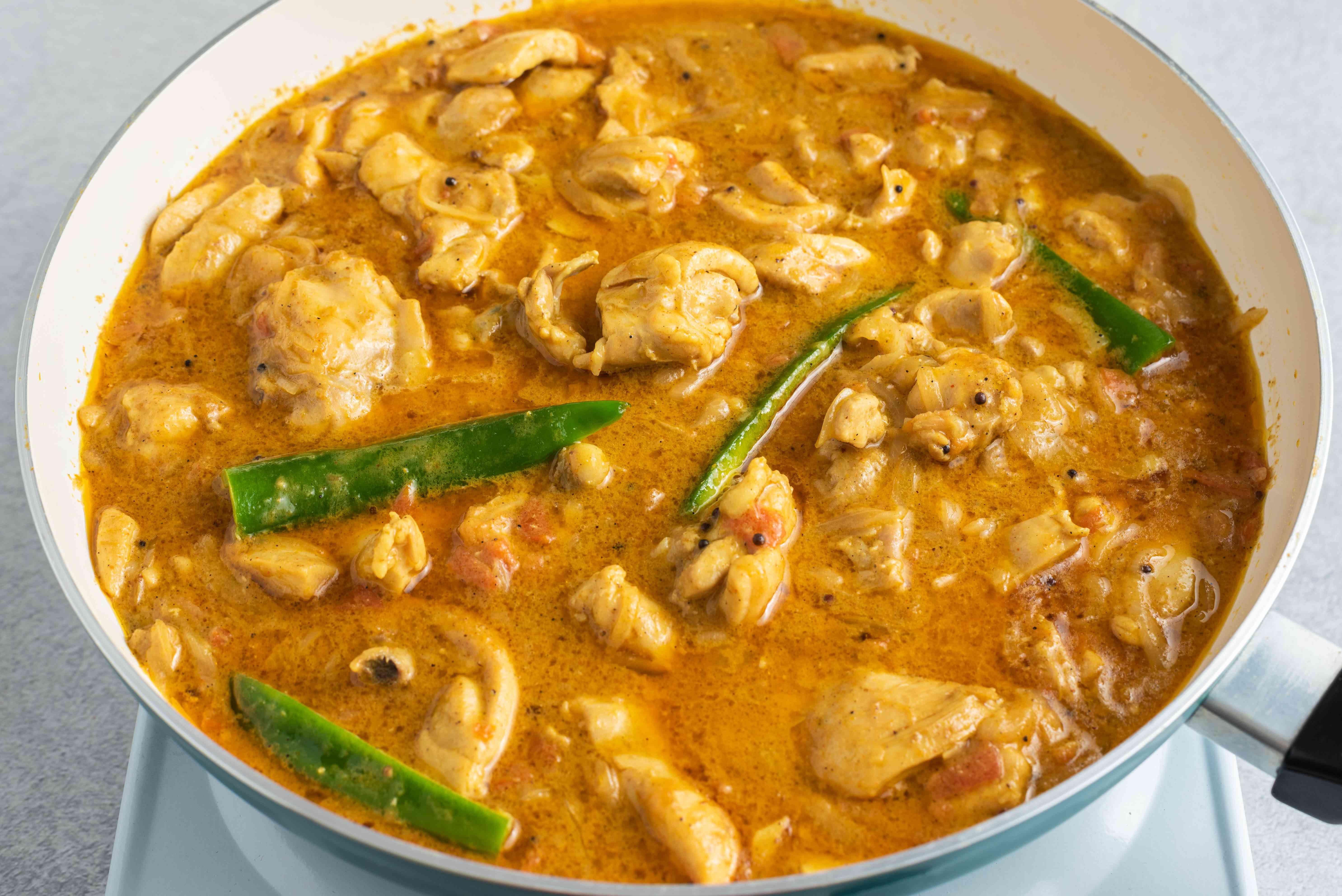 South Indian-Style Chicken Curry with green chiles in a pan