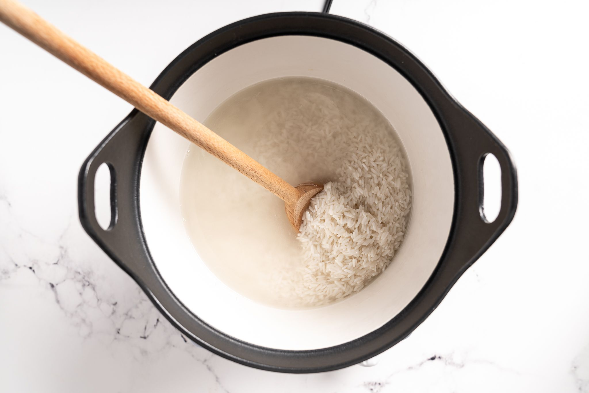 rice and water in a steamer