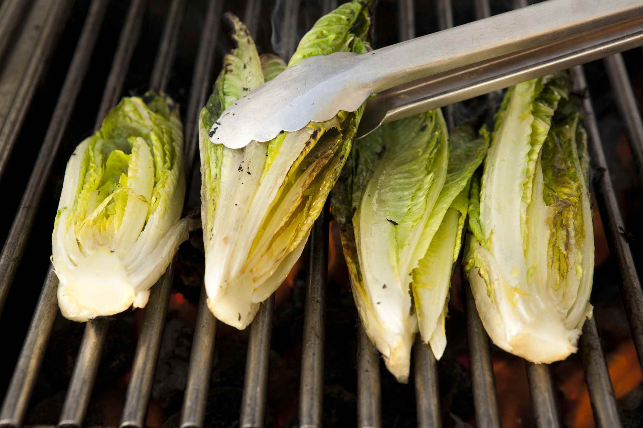 Grilled romaine hearts on a grill
