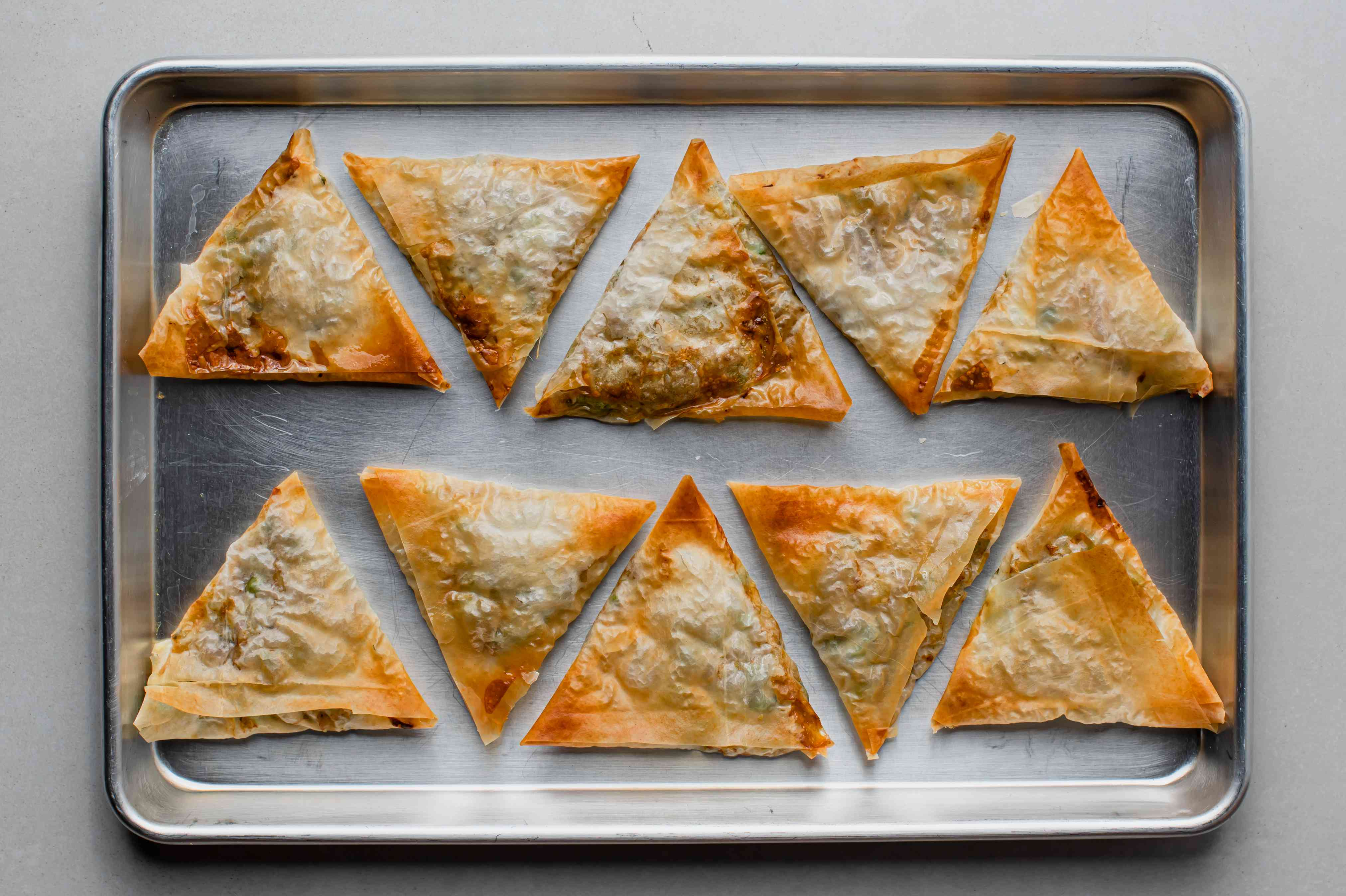 Quick and Easy Baked Vegetarian Samosas on a baking pan