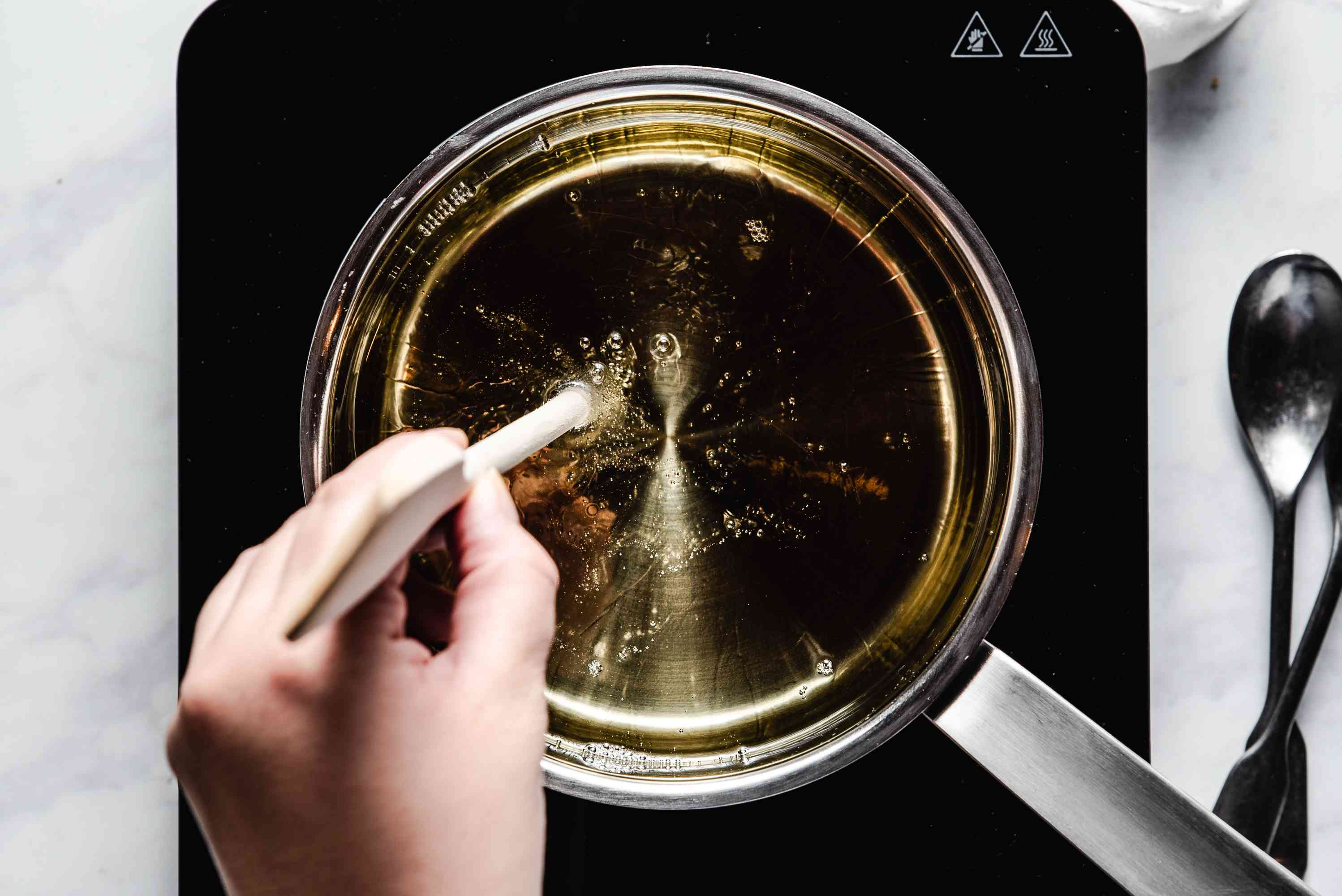 oil in a pot, check oil with a wooden spoon