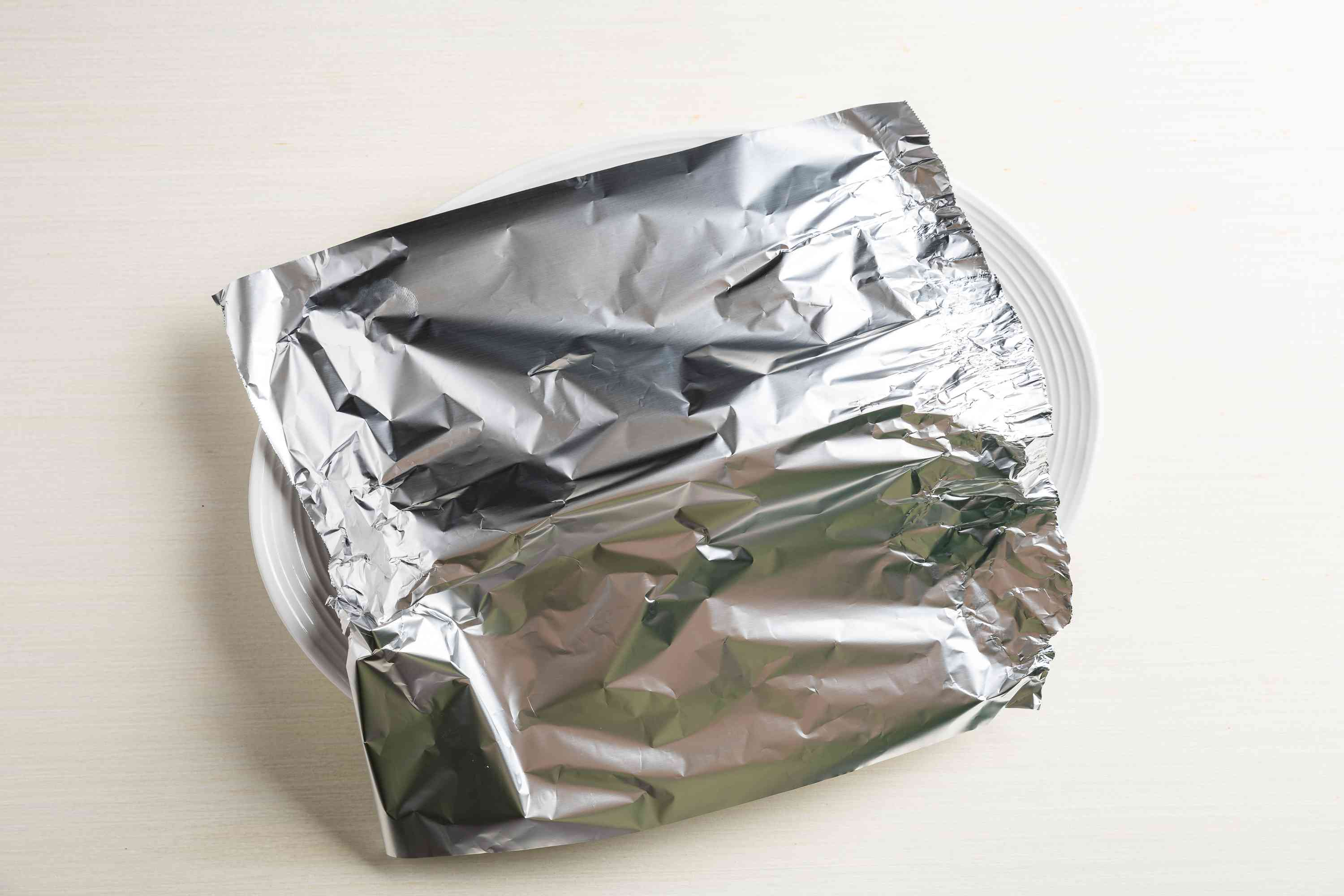 Better BBQ Chicken Legs covered with aluminum foil