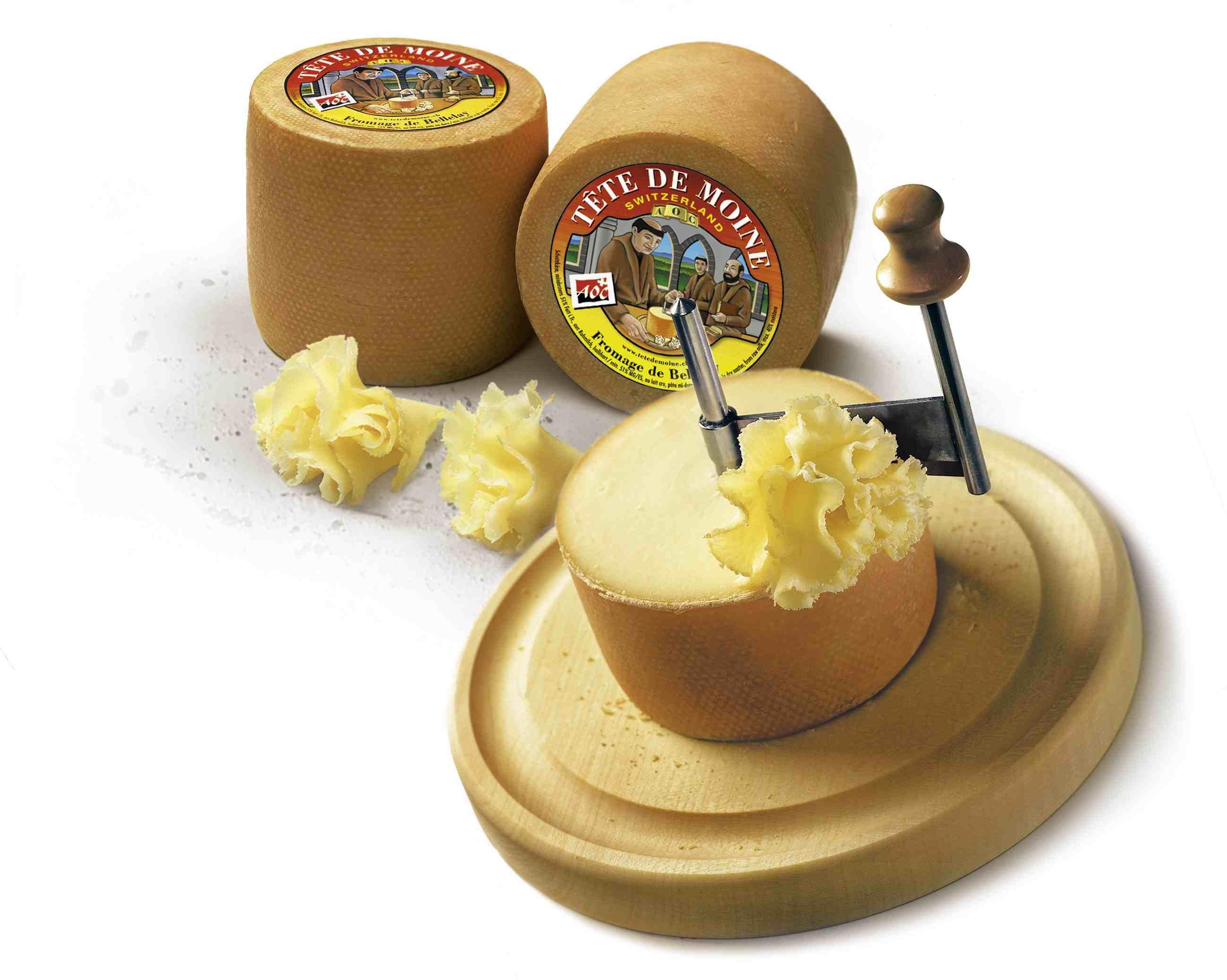 Tête de Moine on cheese round slicer.