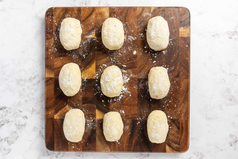 floured mashed potato balls with ground beef inside