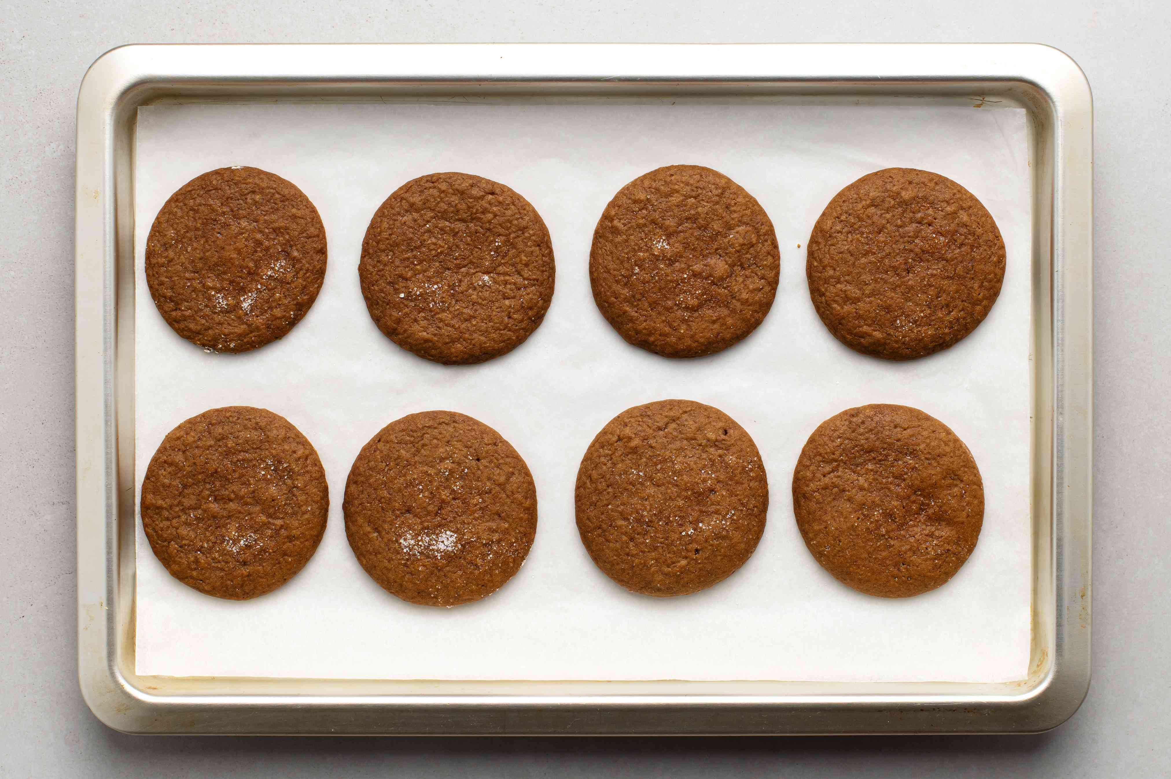 Old-Fashioned Molasses Cookies on a parchment paper lined baking sheet