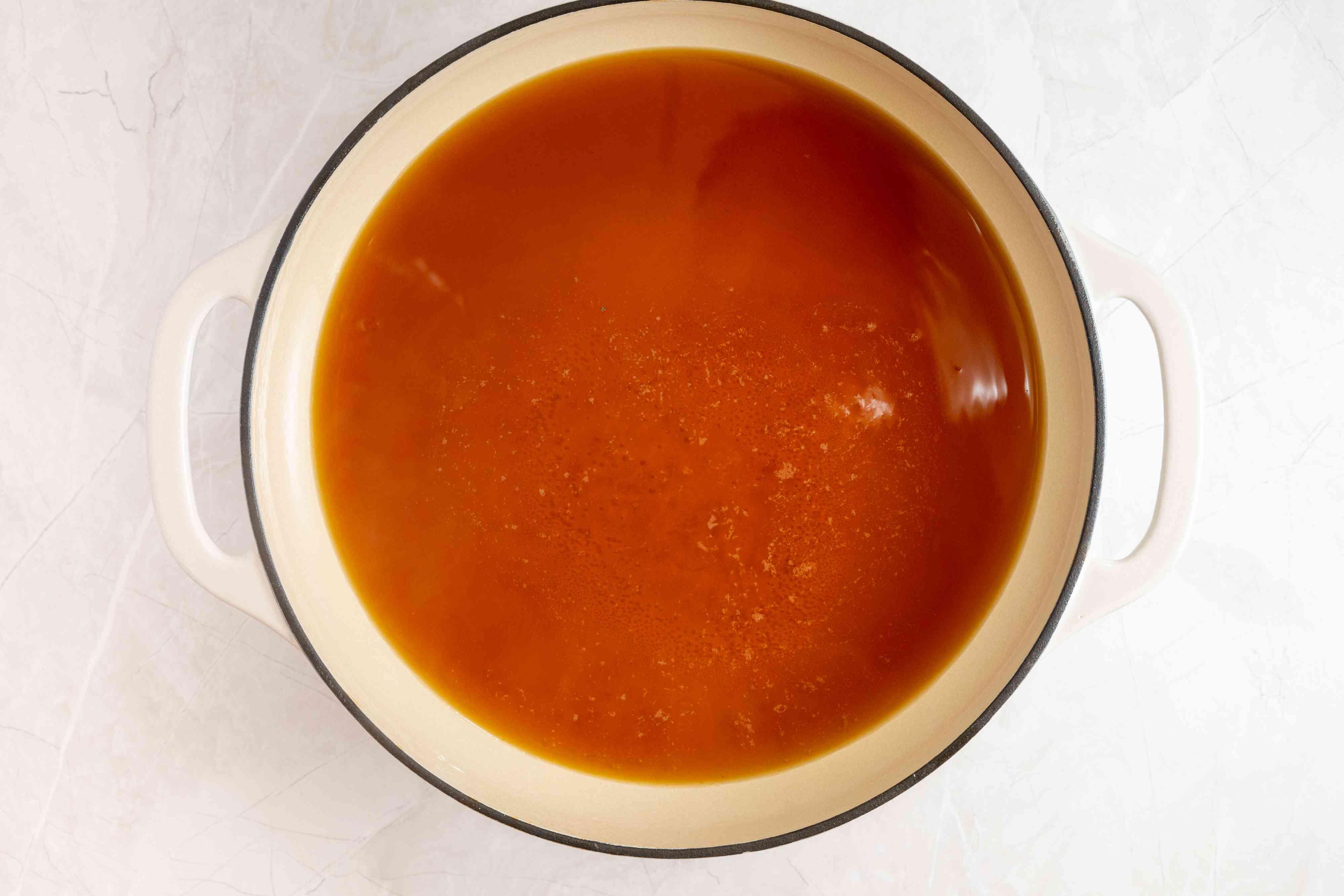 dashi, soy sauce, sugar, mirin, and sake in a large pan