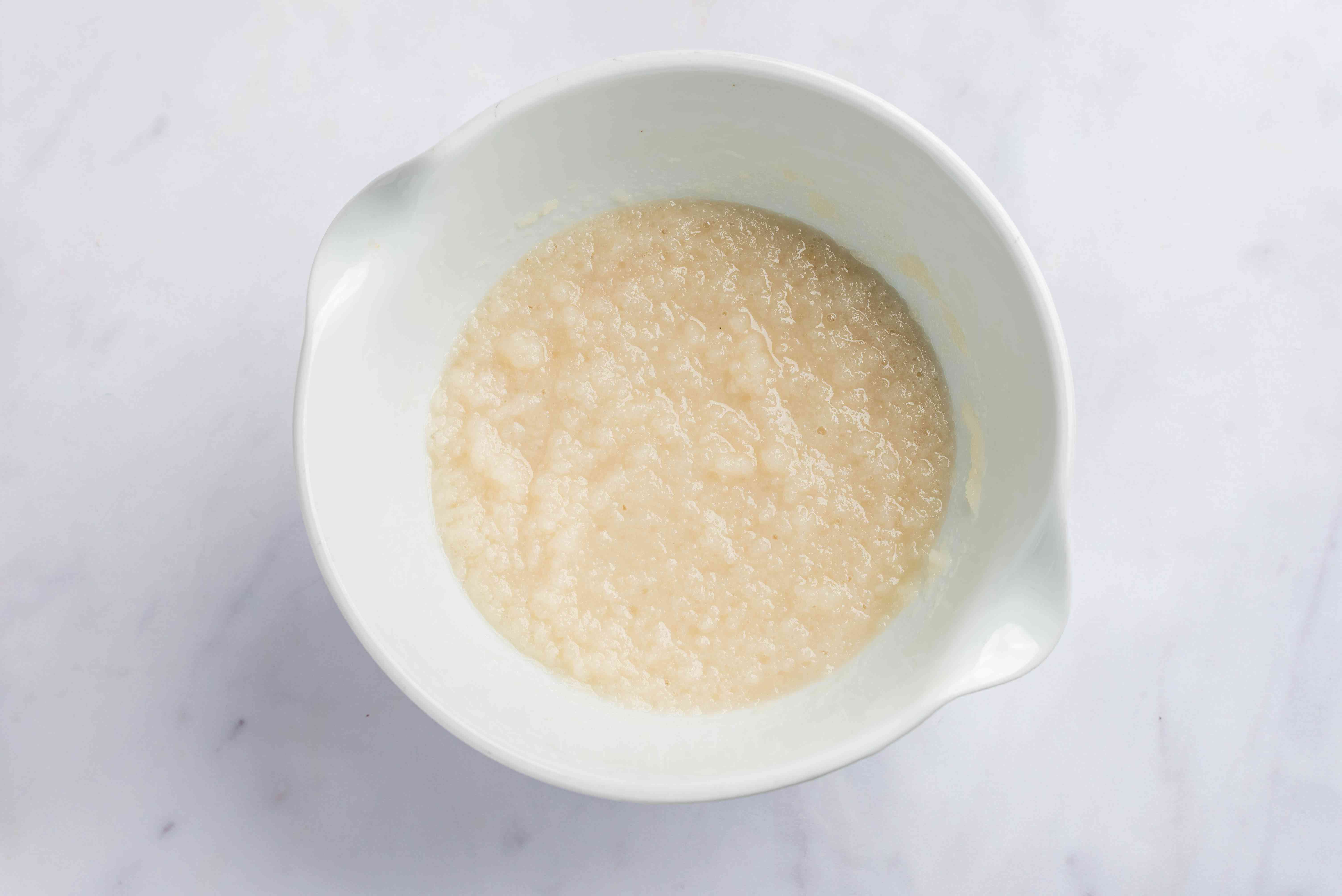 Warm water, sugar, yeast, and potato flakes are mixed together