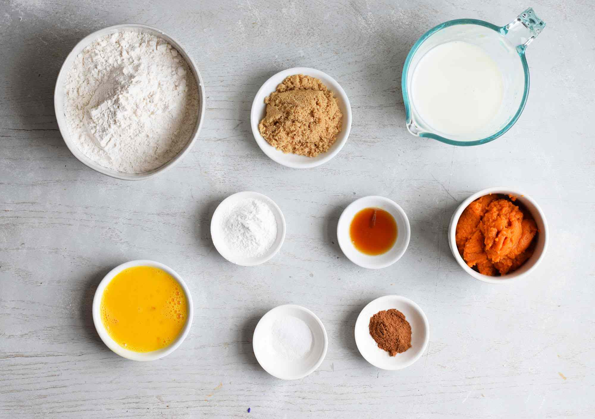 ingredients for pumpkin pancakes on a board