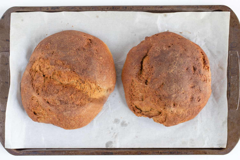 Pumpernickel Bread loafs on a baking sheet
