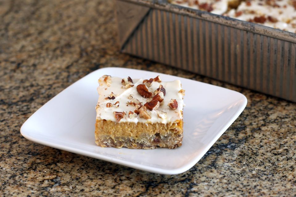 pumpkin bars with pecans and cream cheese topping