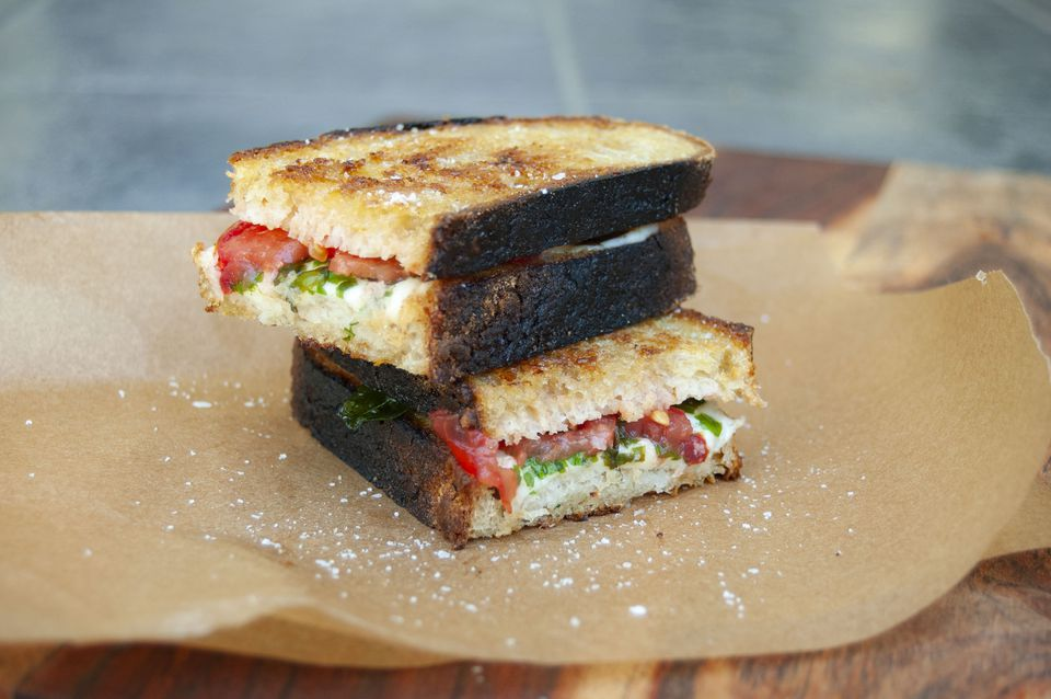 fresh tomato, fried basil and fresh mozzarella on homemade sourdough bread - it's caprese grilled cheese!