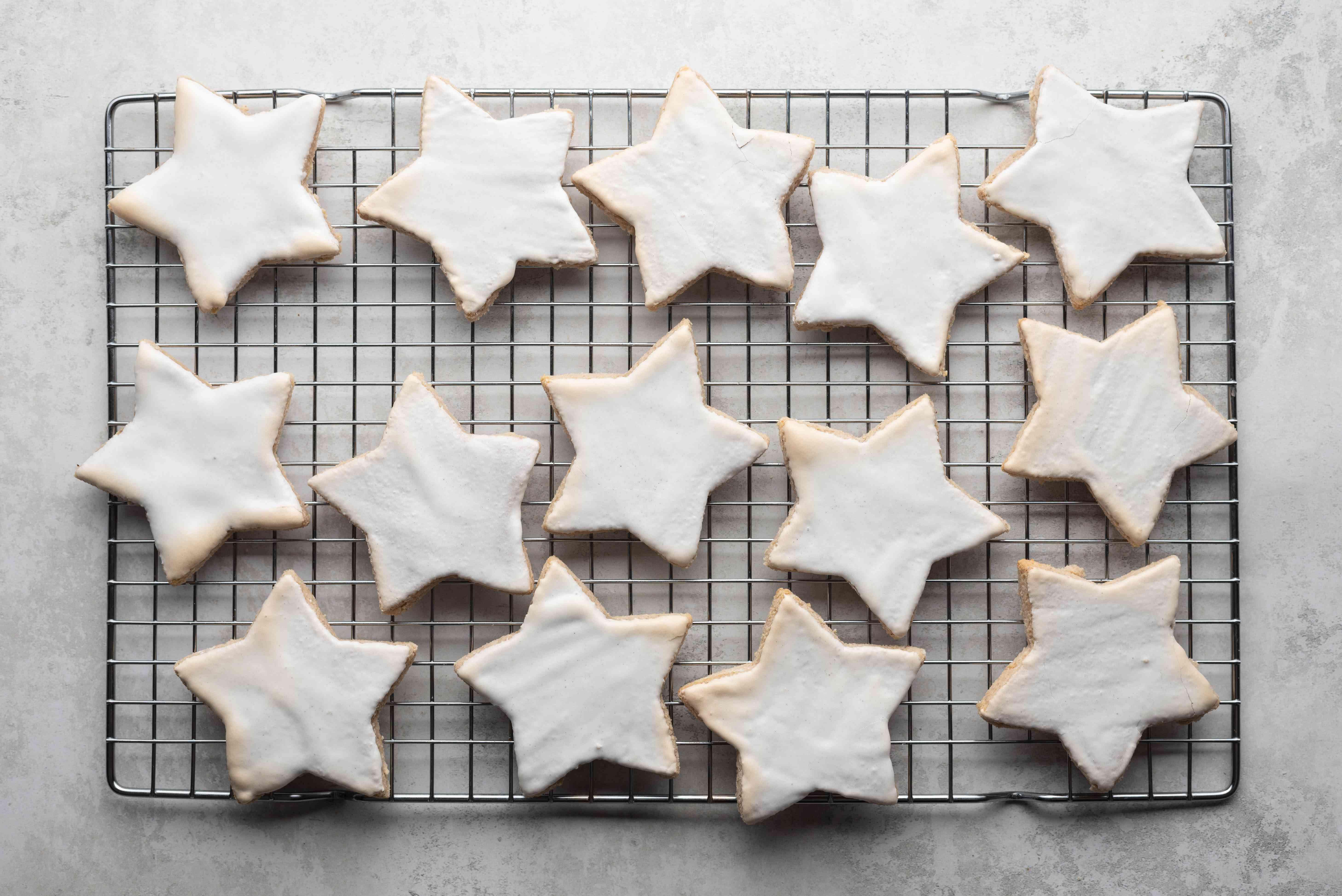 German Cinnamon Star Christmas Cookies (Zimtsterne) on a cooling rack