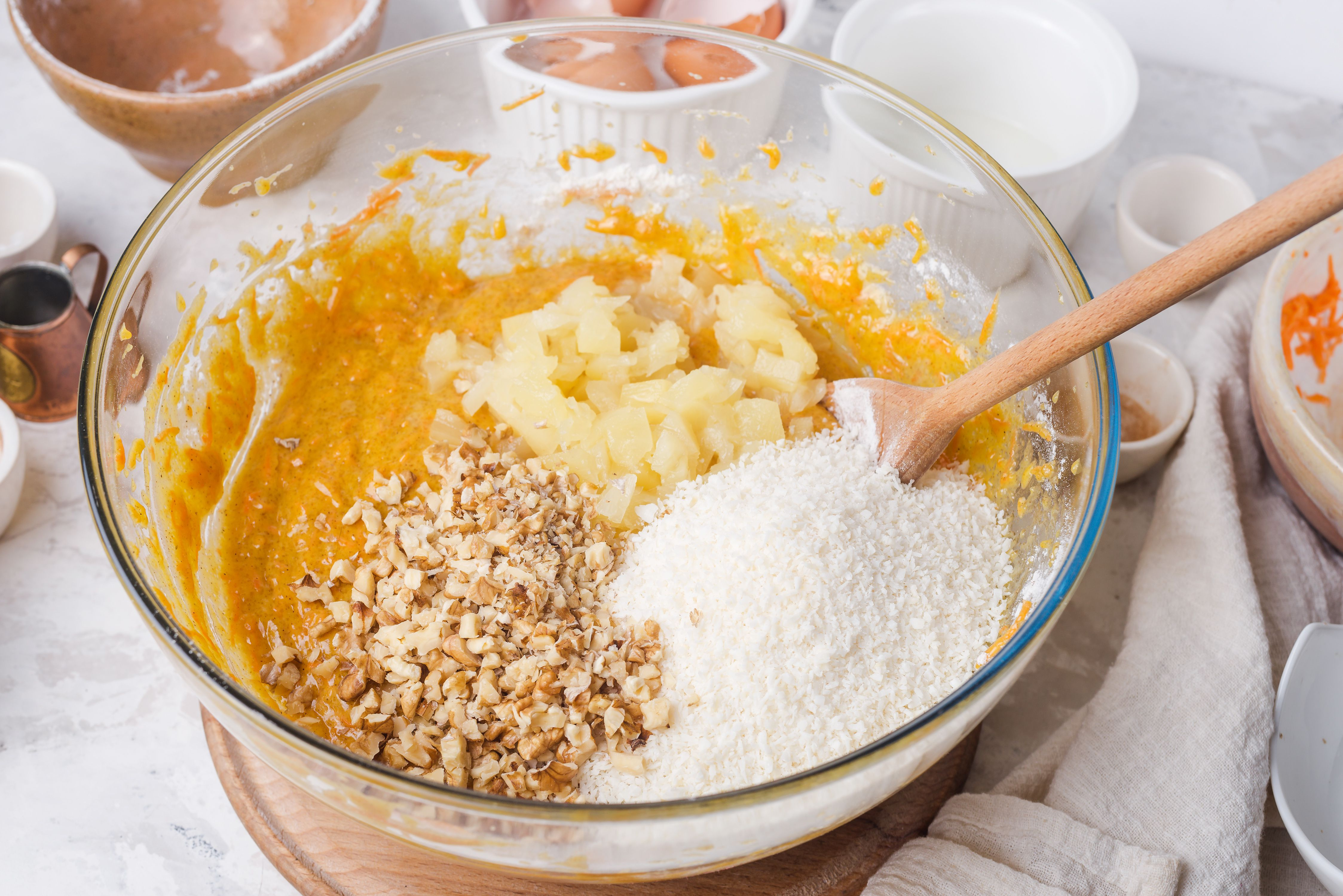 Pineapple, nuts, and coconut added to batter