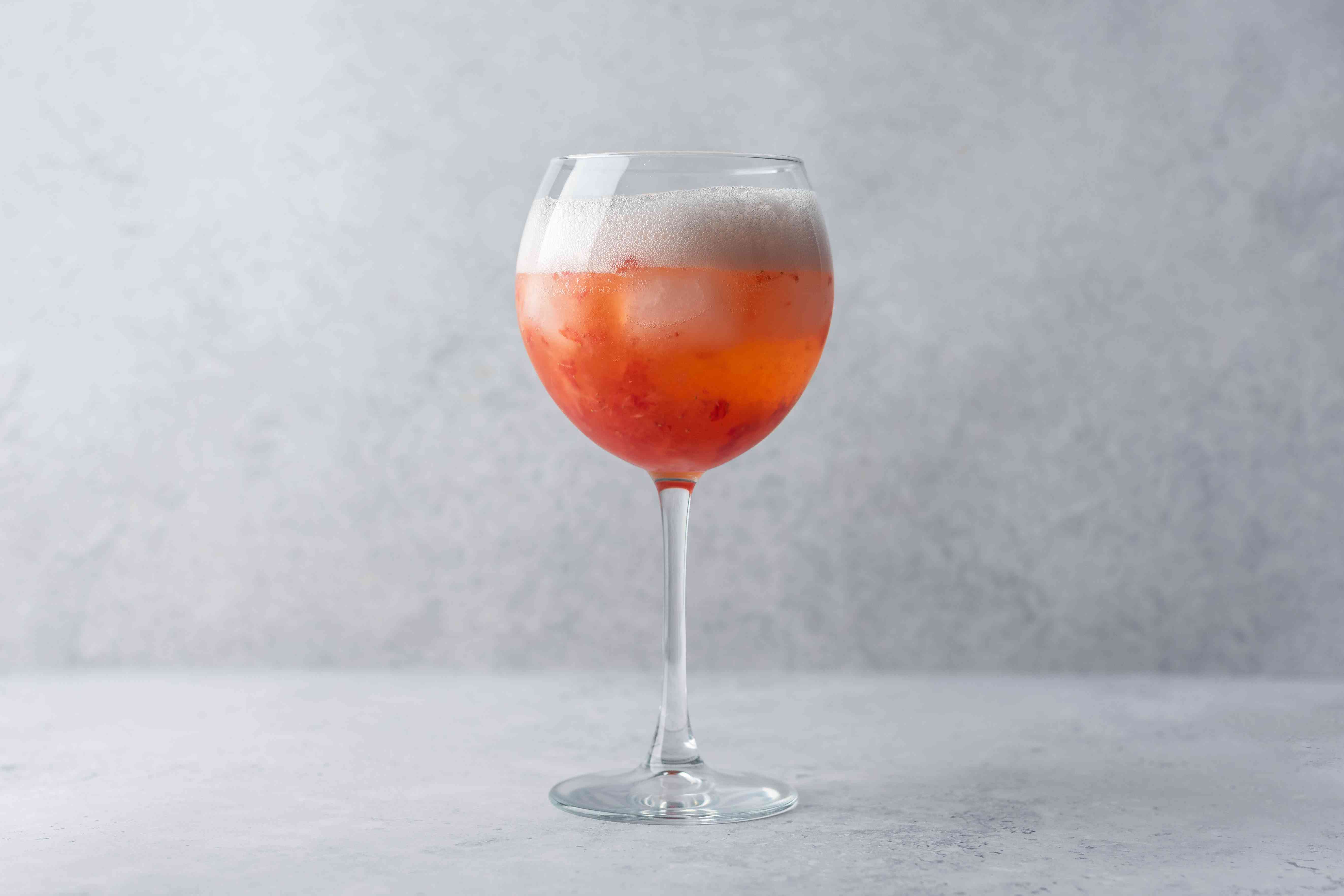 Top the cocktail with sparkling wine