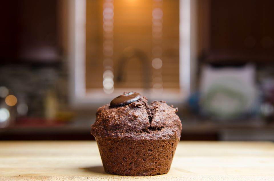 Chocolate muffin on countertop
