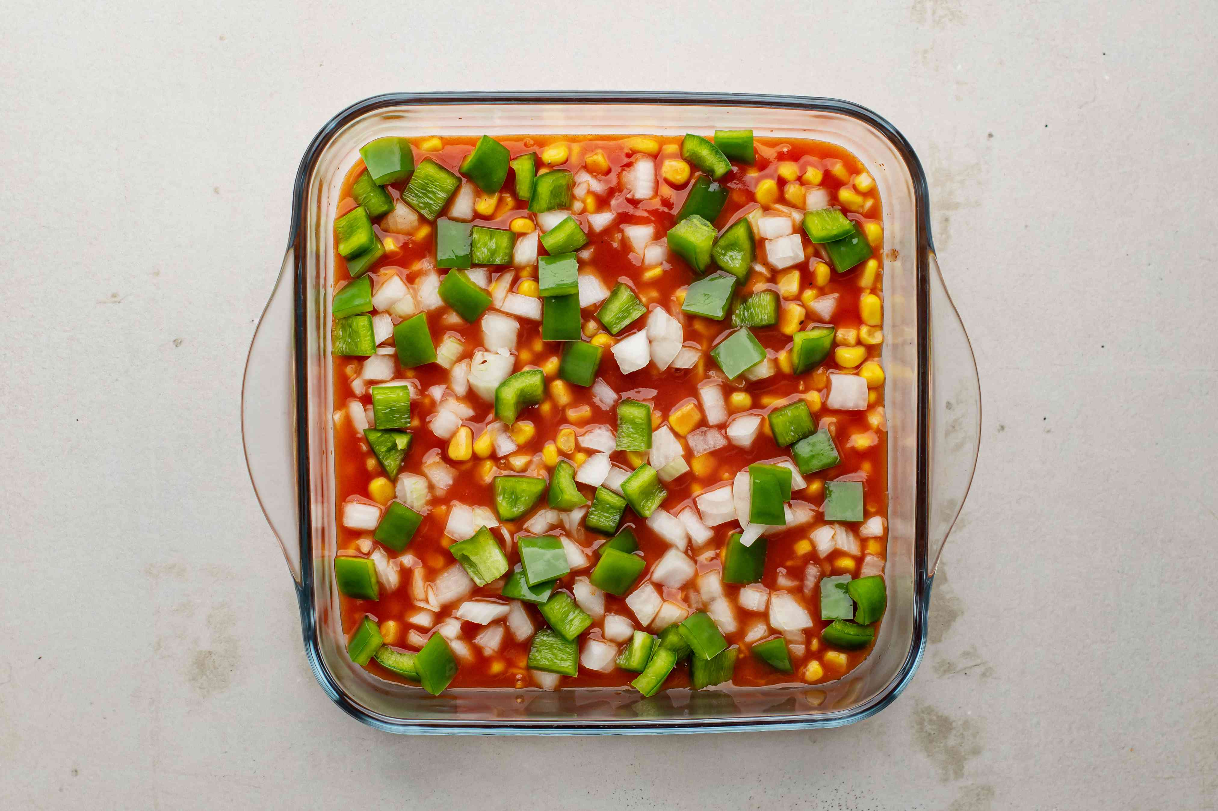 Sprinkle with chopped onion and bell pepper