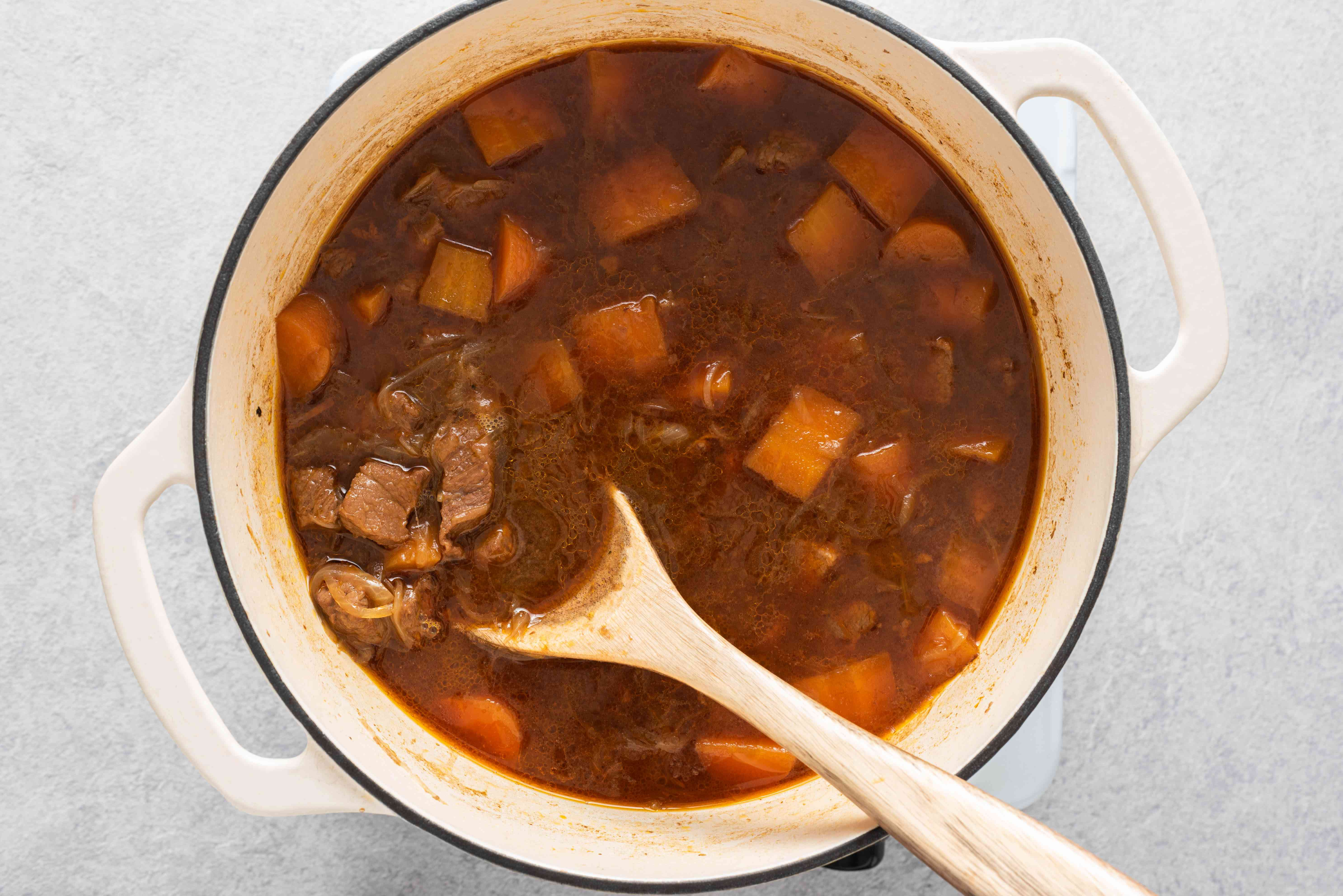 beef and Guinness pie filling cooking in a casserole pot