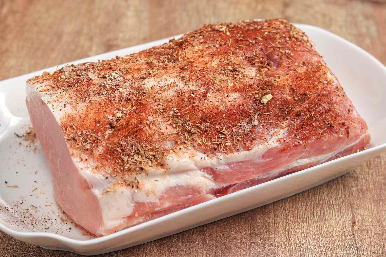 Rub pork with seasoning mixture