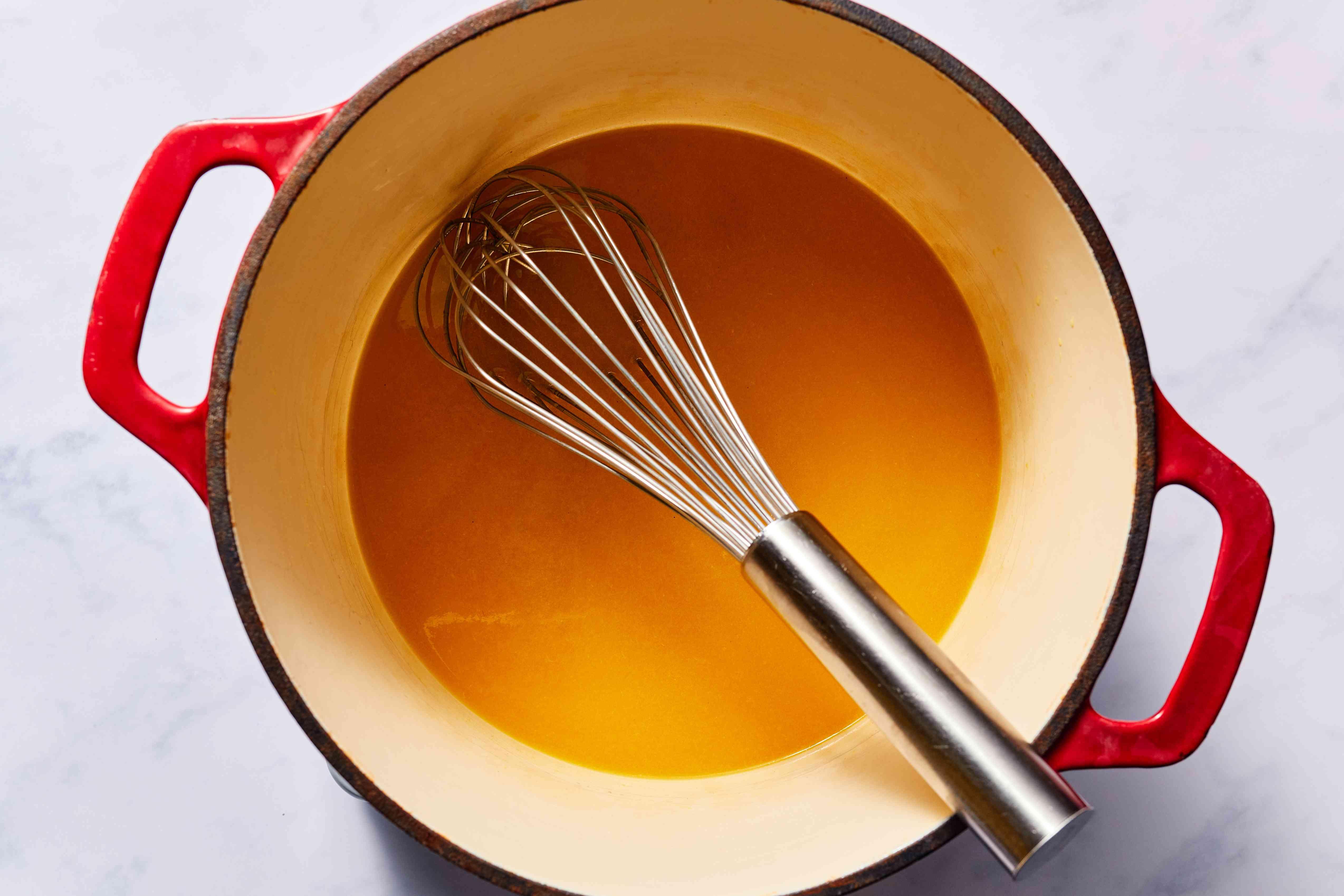 orange juice ans sugar in a pot