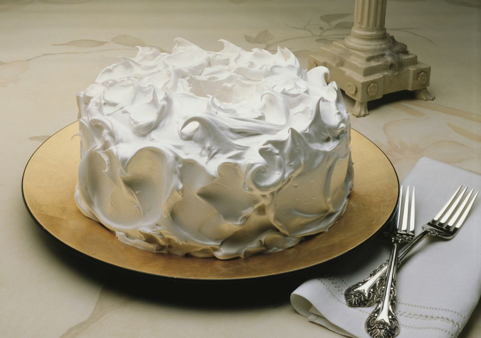 Fluffy white frosting on a cake