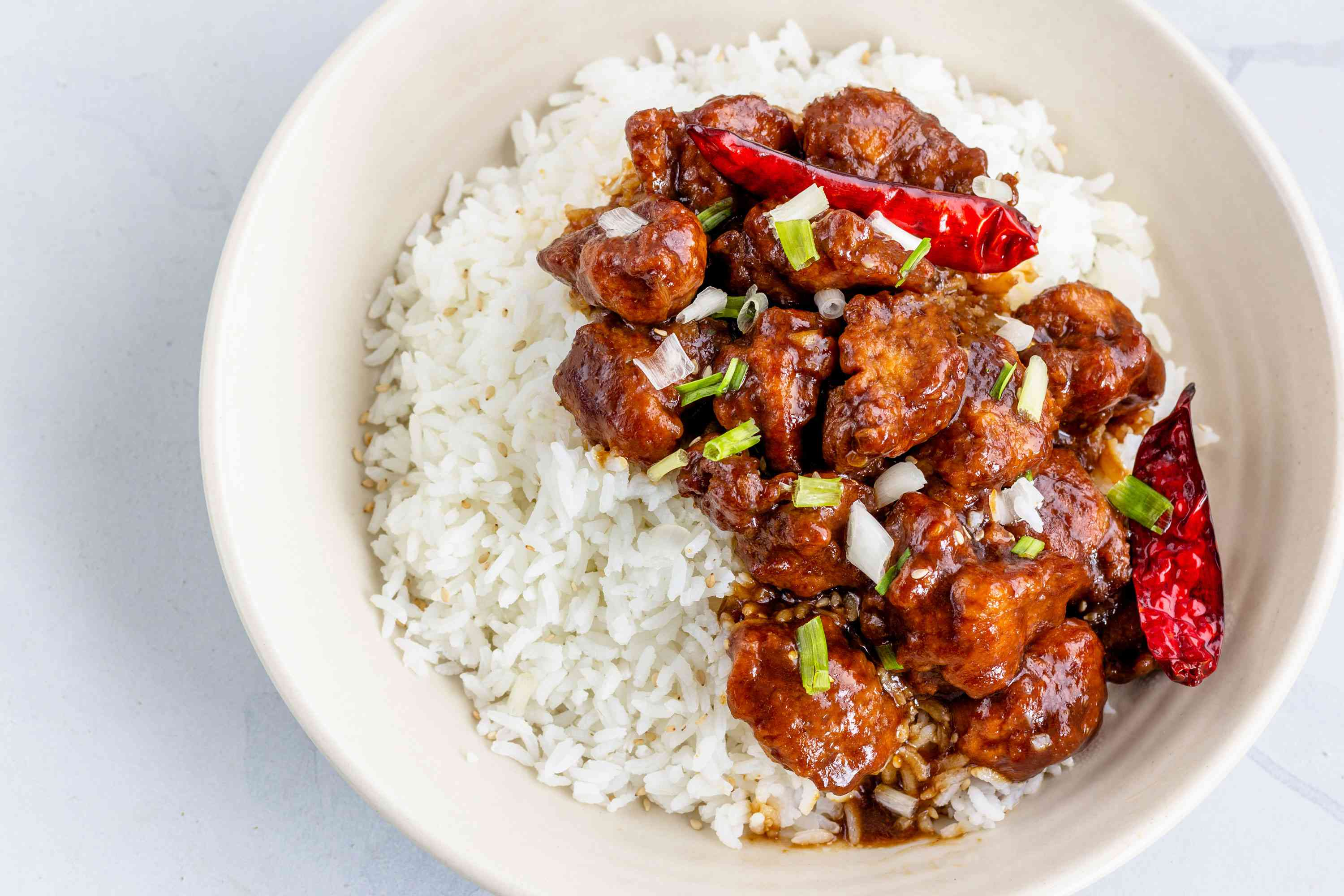 A bowl of General Tso's chicken served over rice