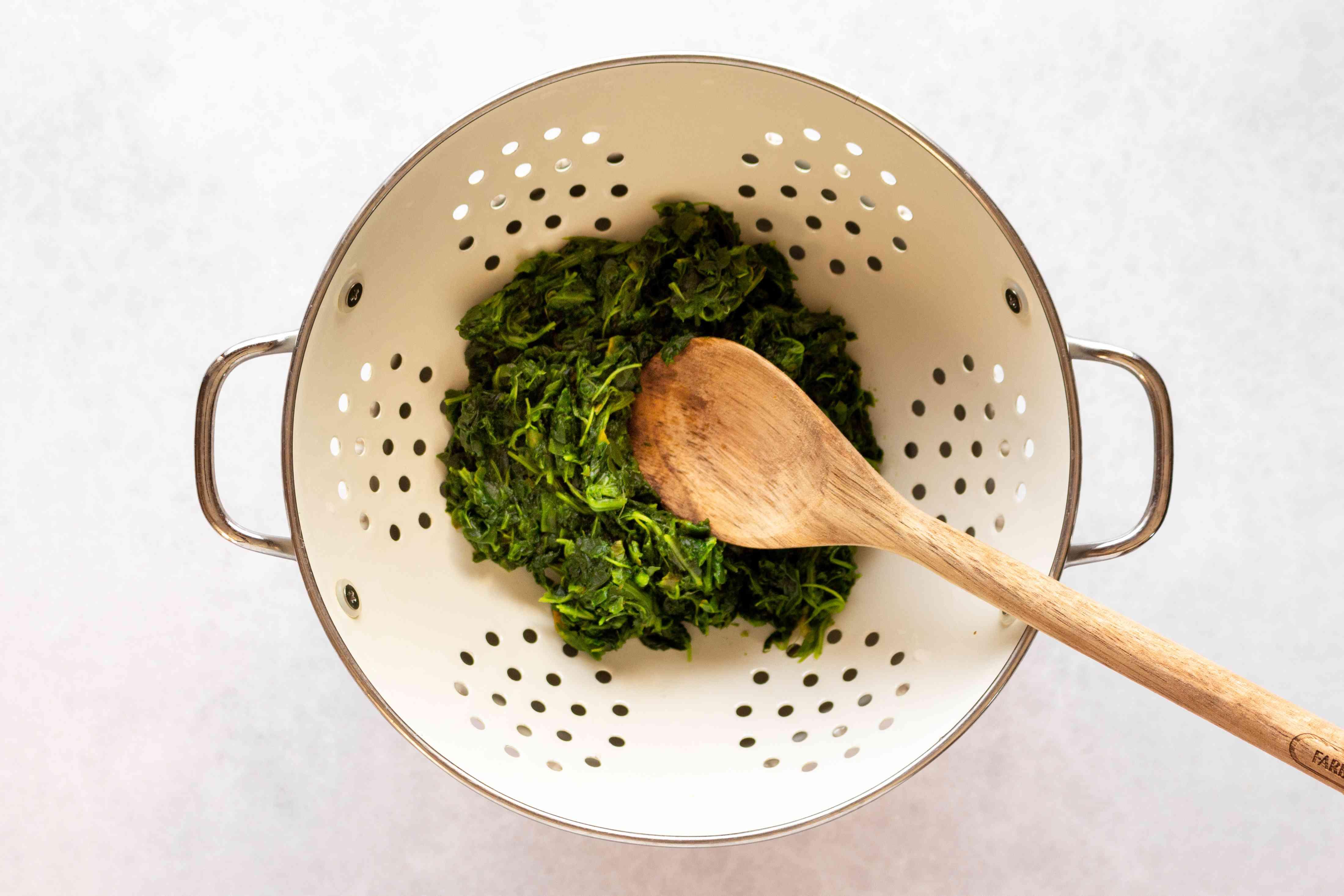 spinach in a colander
