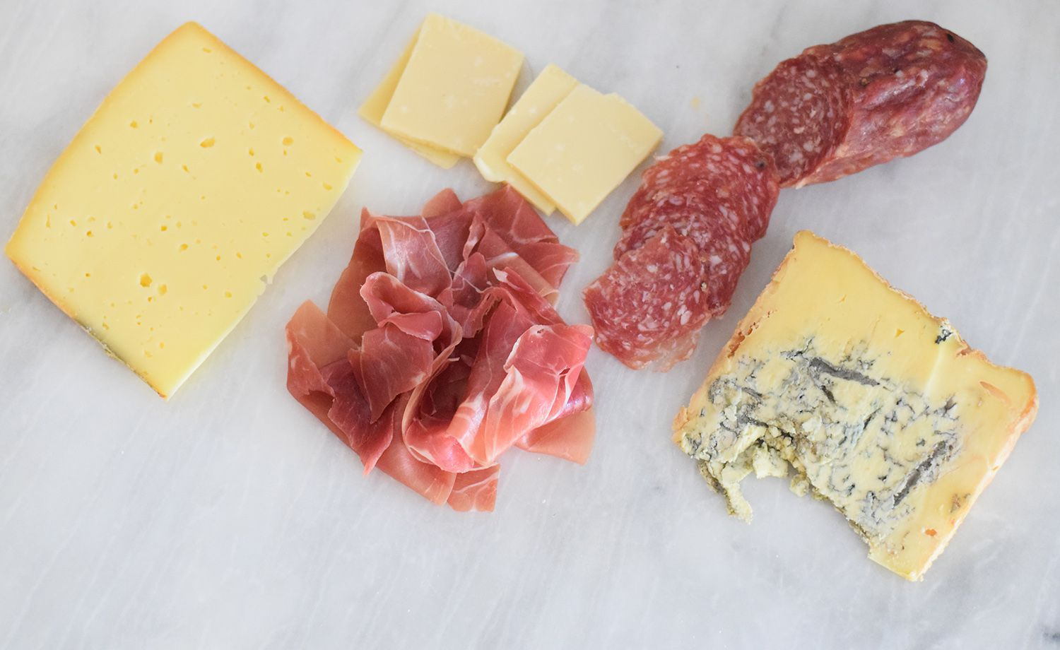 Various meats and cheeses