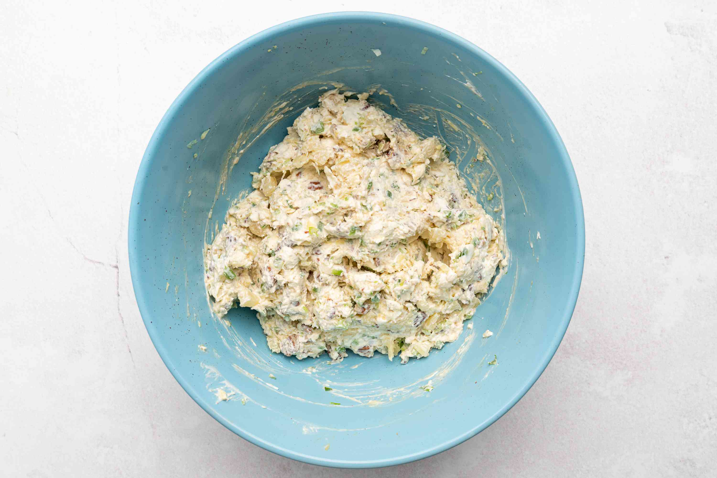 cream cheese, drained crushed pineapple, chopped bell pepper, and chopped green onion in a bowl