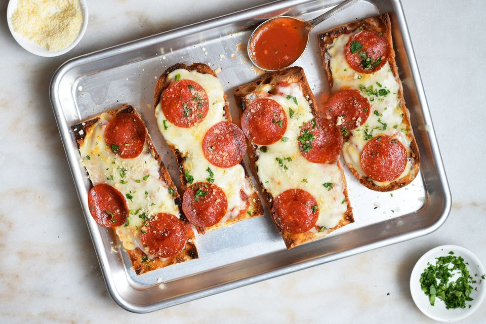 french bread pizza on a sheet tray