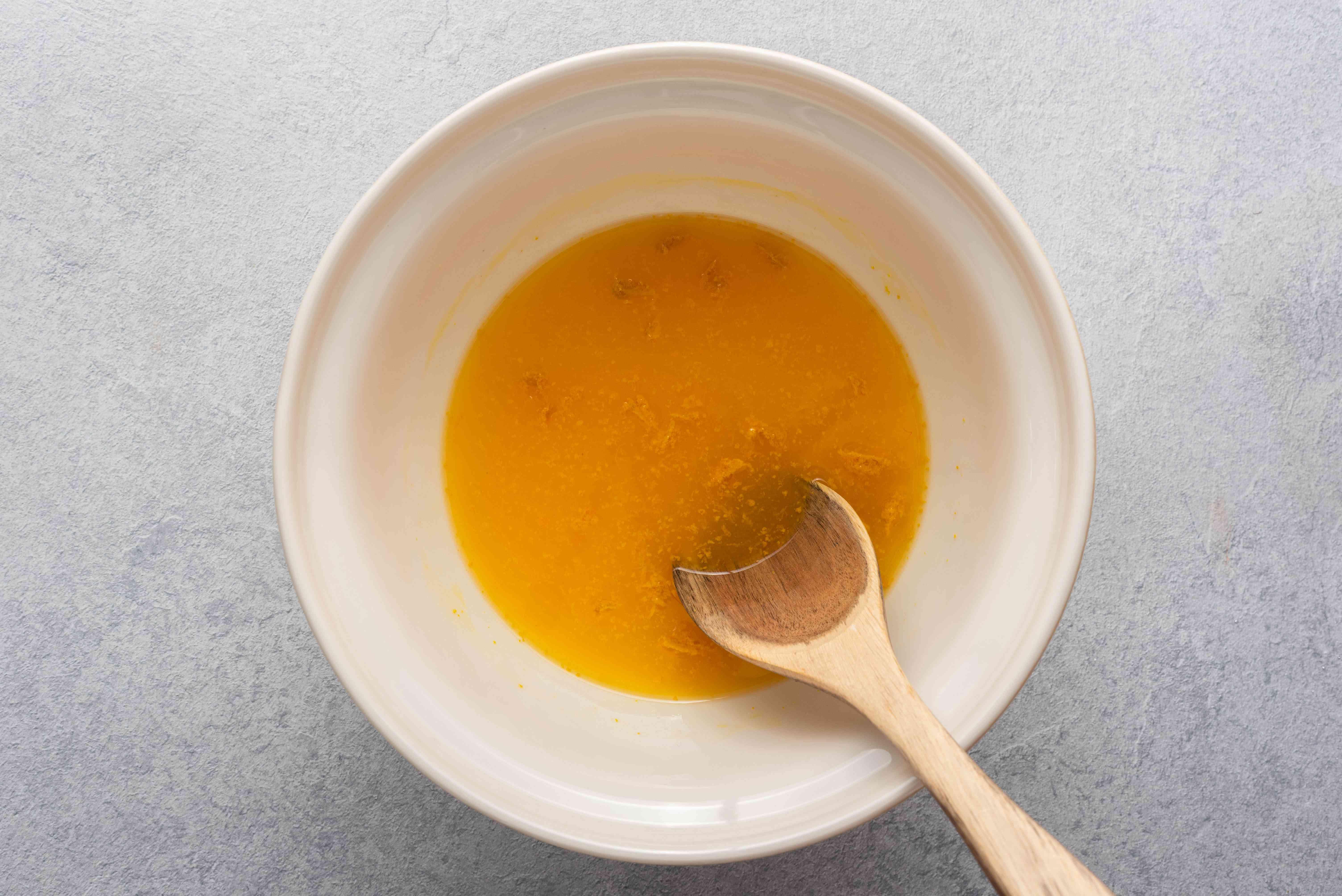 Orange juice, zest, and sugar in a bowl