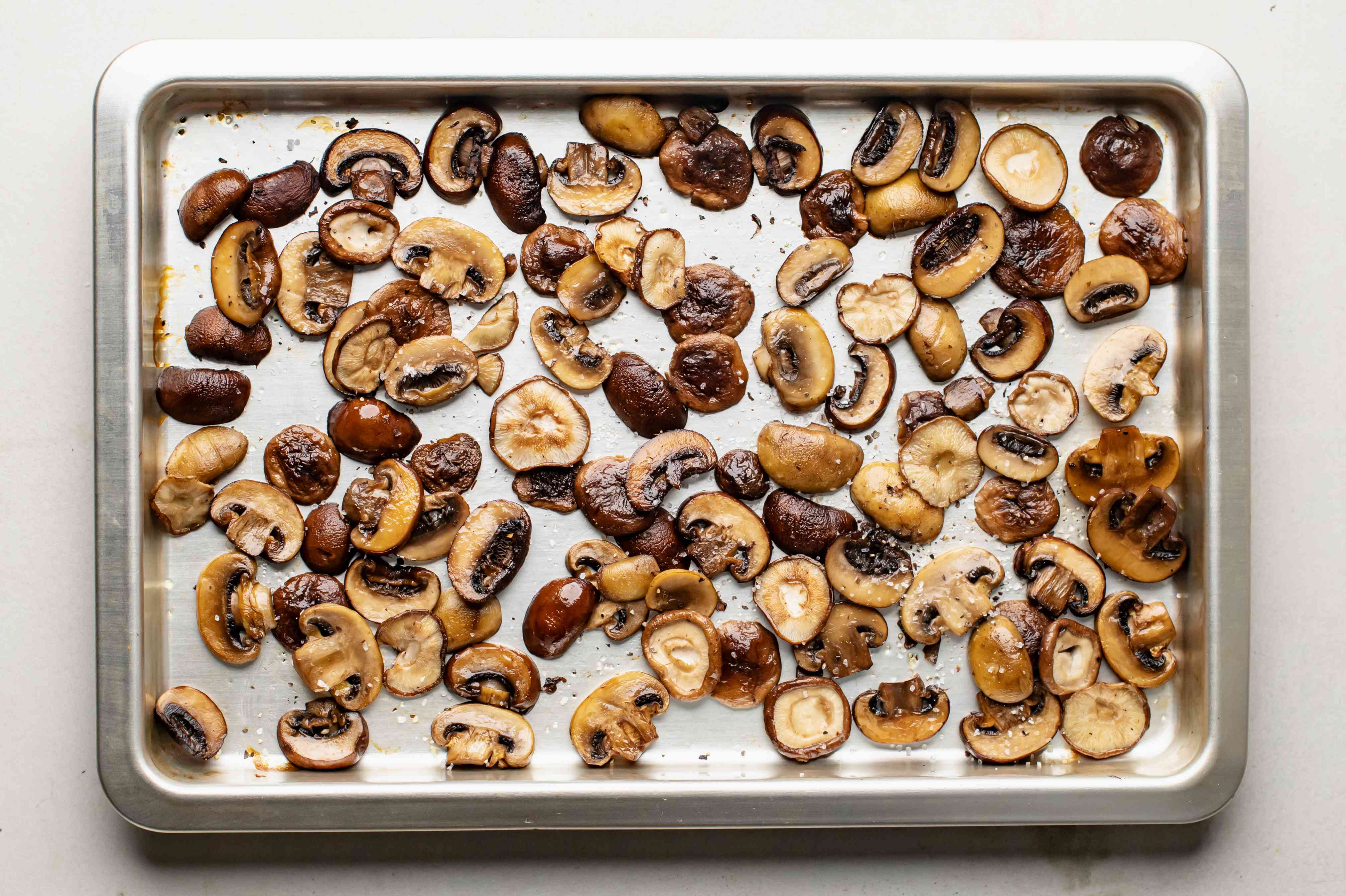 Toss mushrooms on baking tray