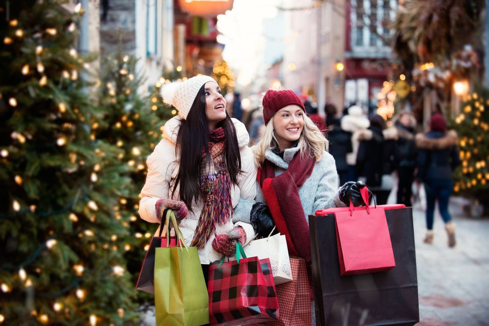women with tons of shopping bags, Christmas trees