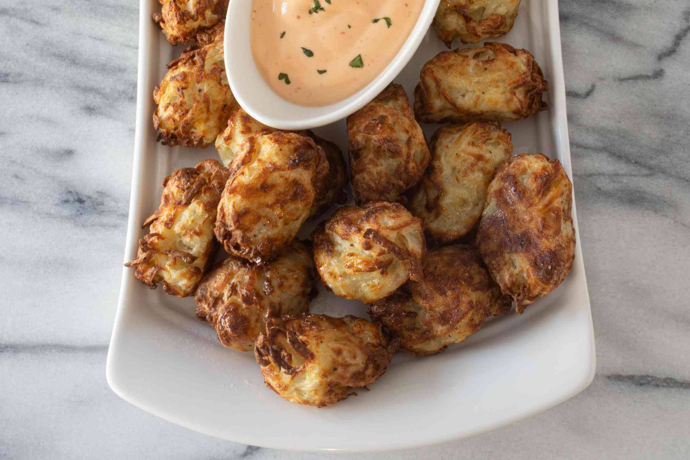Finished tater tots with the spicy dip.