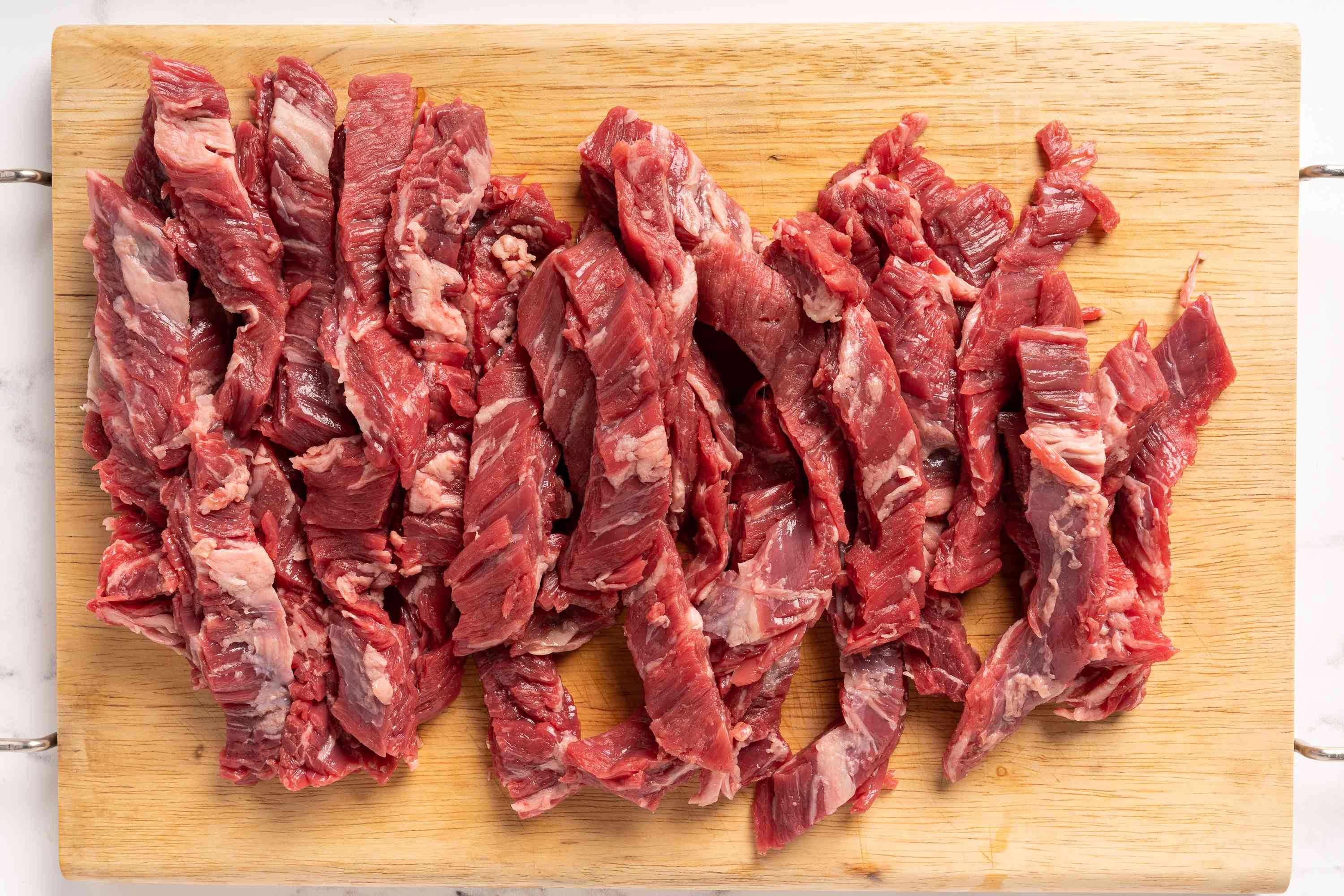 Slice the steak across the grain and into thin strips