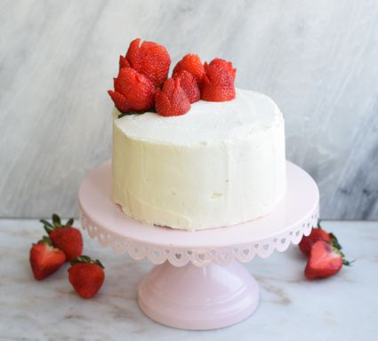 strawberries on top of lemon cake