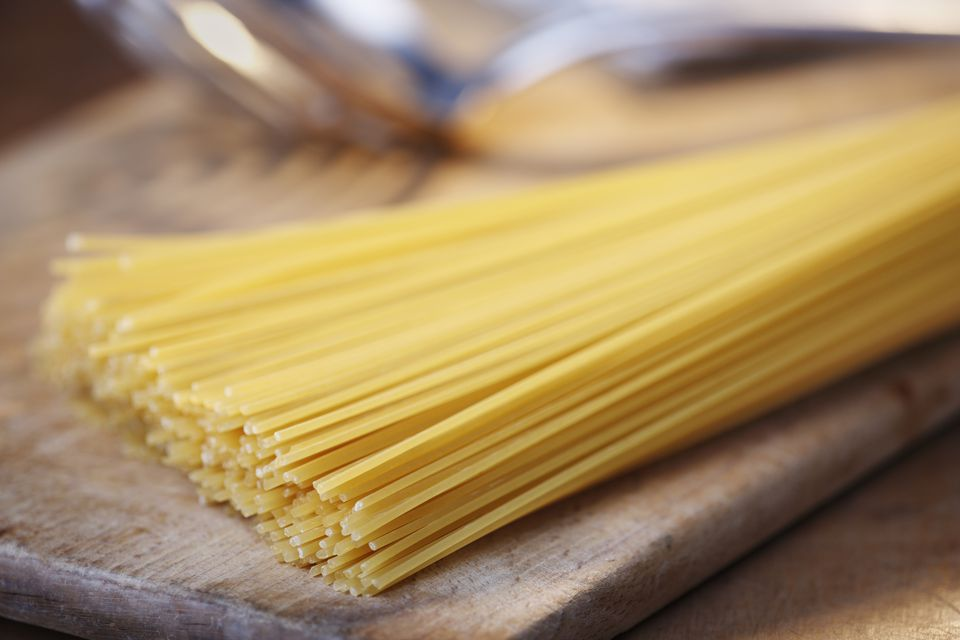 Spaghetti on chopping board, close-up