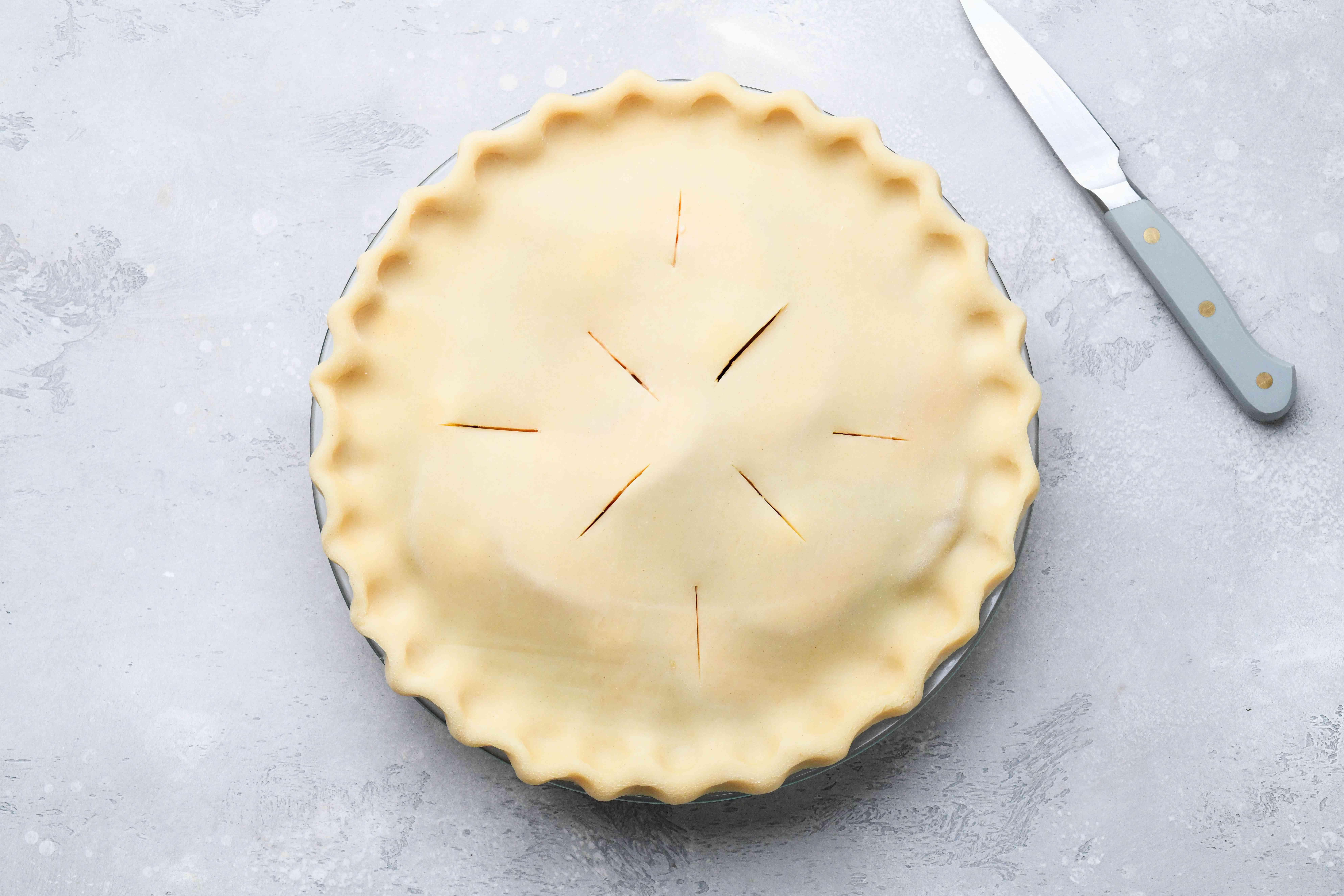 pie crust on top of the peach pie