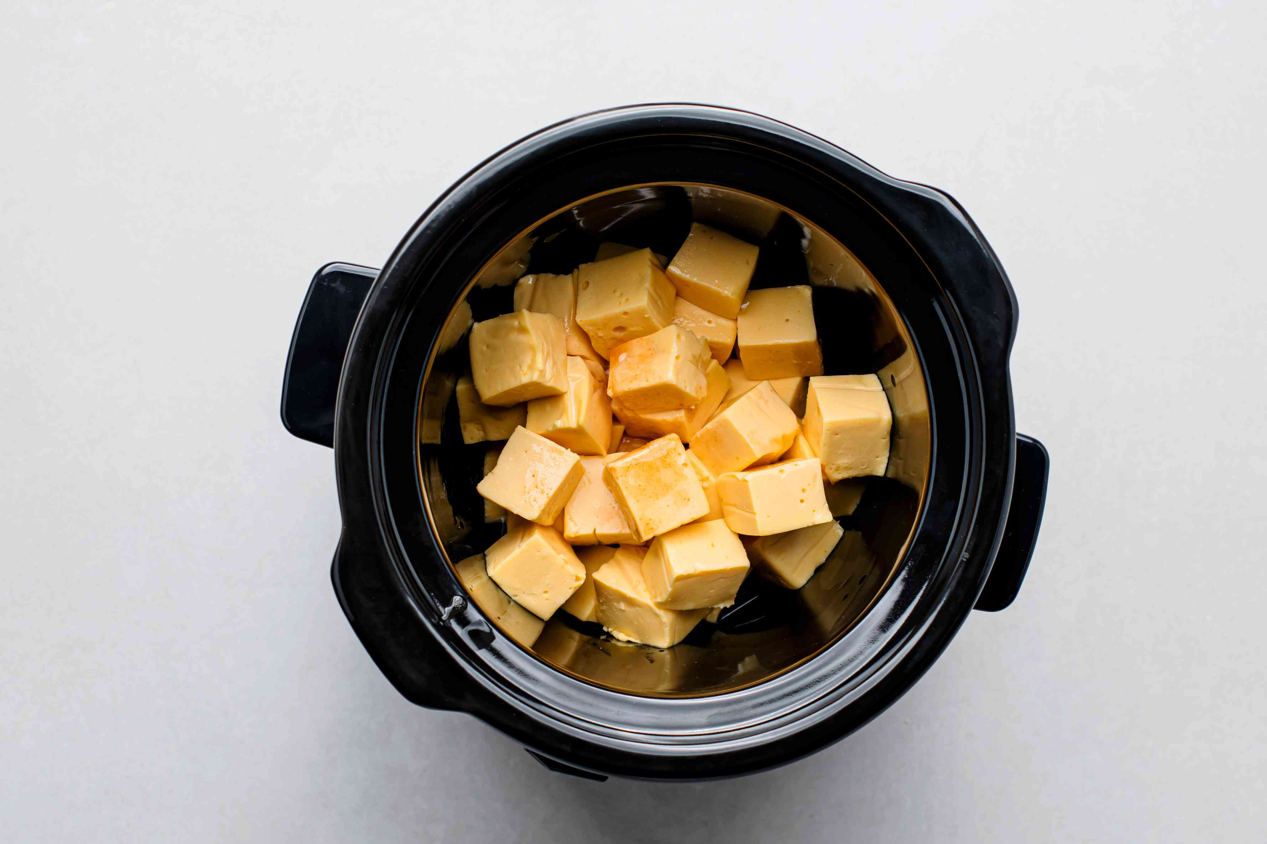 beer, Tabasco sauce, and processed cheese spread in a 1 to 2-quart slow cooker