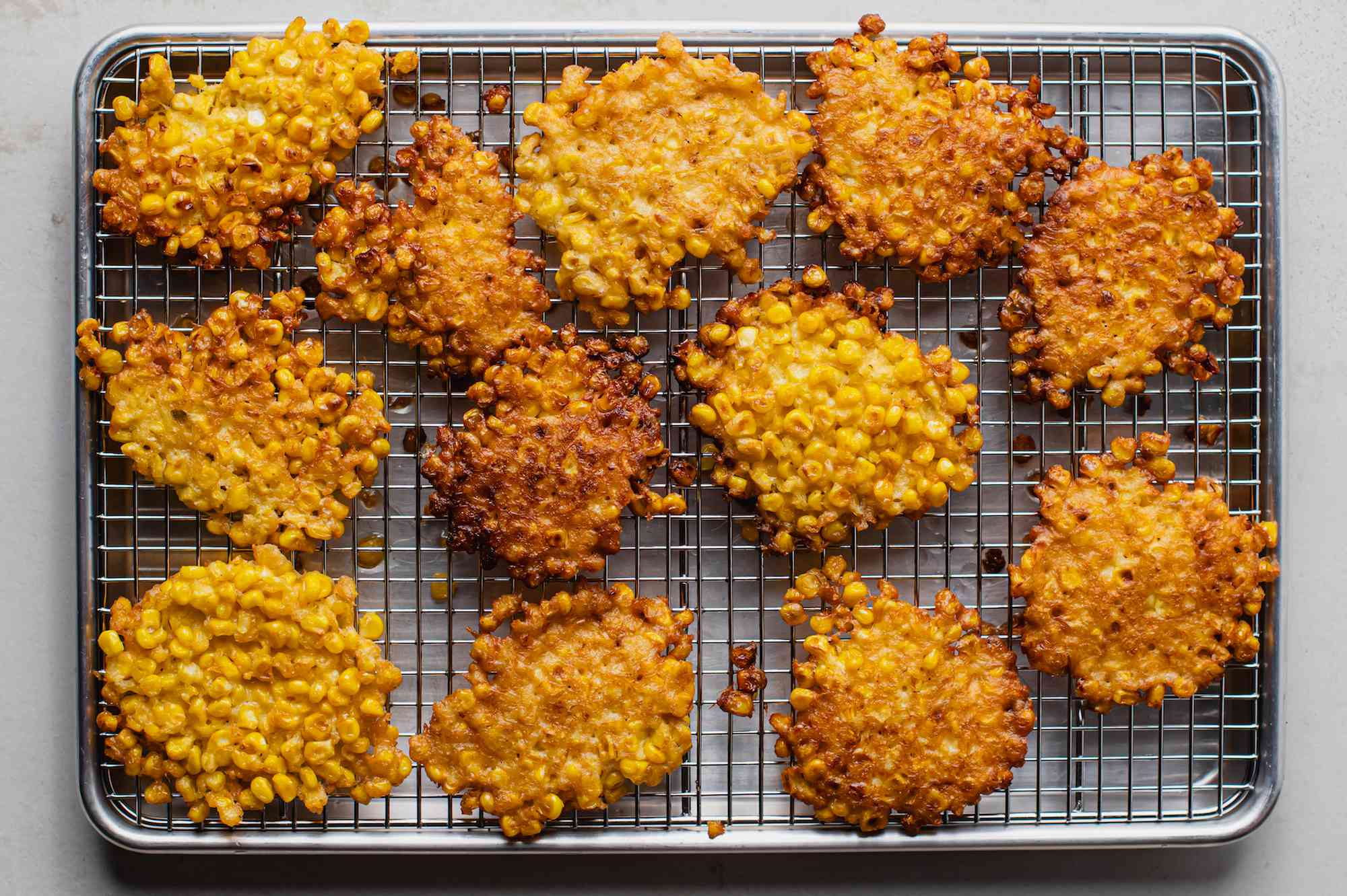 Corn fritters on a cooling rack