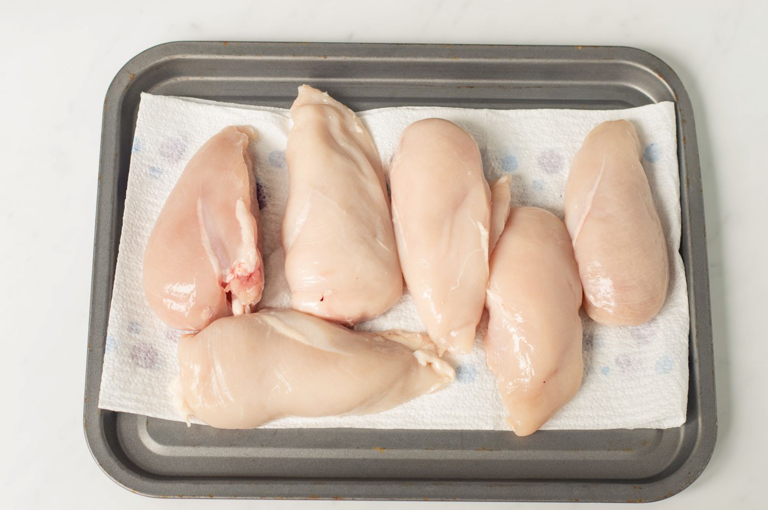 Chicken breasts drying on paper towels