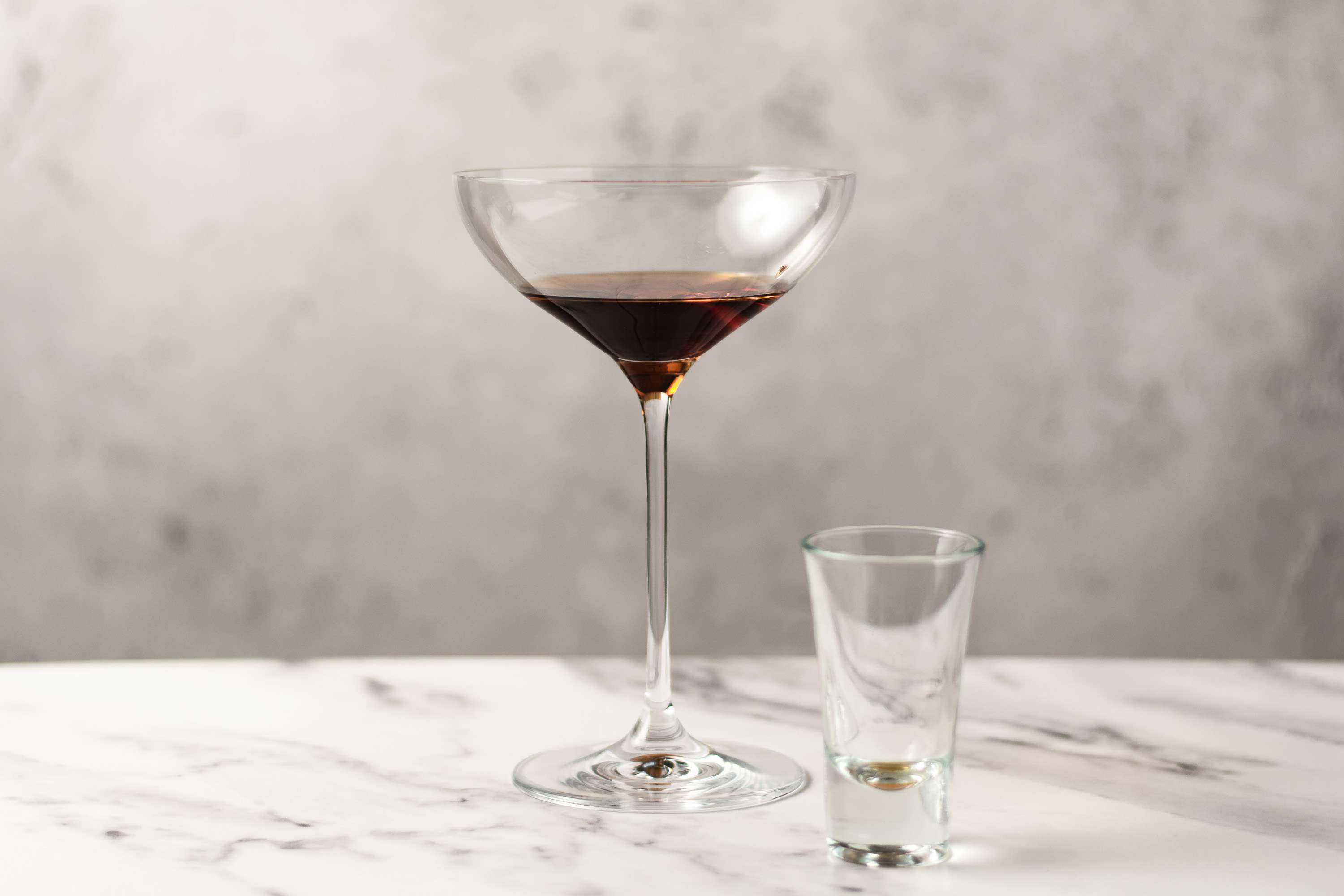 Pour the vermouth directly into a cocktail glass without ice