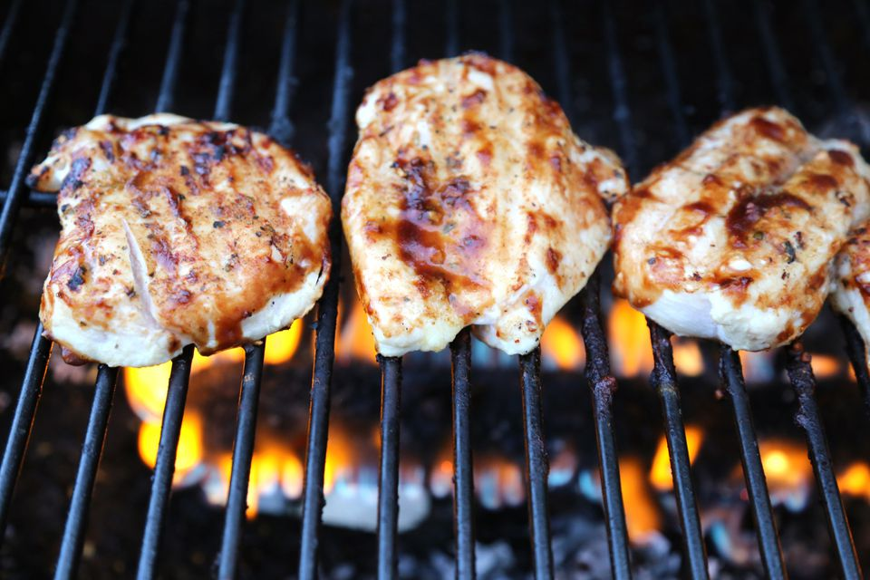 Chicken meat with barbecue sauce cooking on the grill