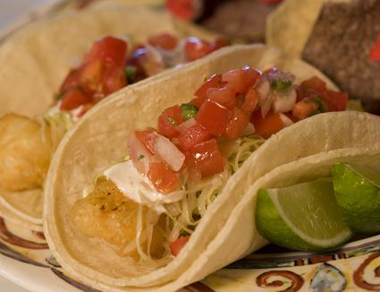 Fish tacos with lime wedges on the side
