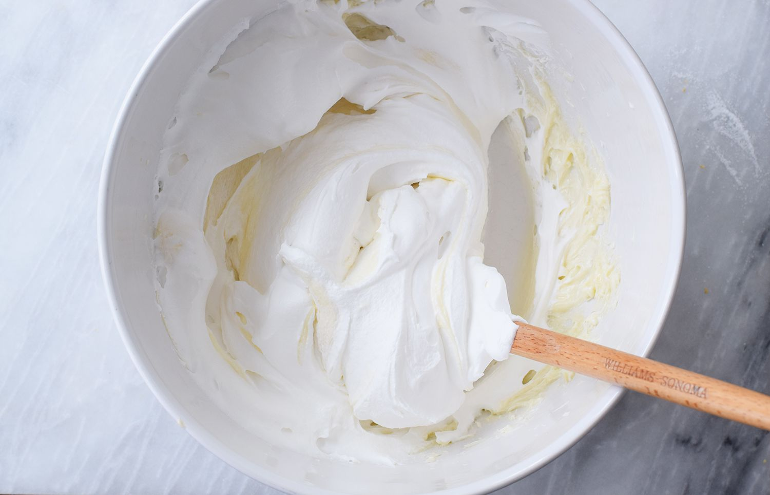 Whipped cream folded into cream cheese