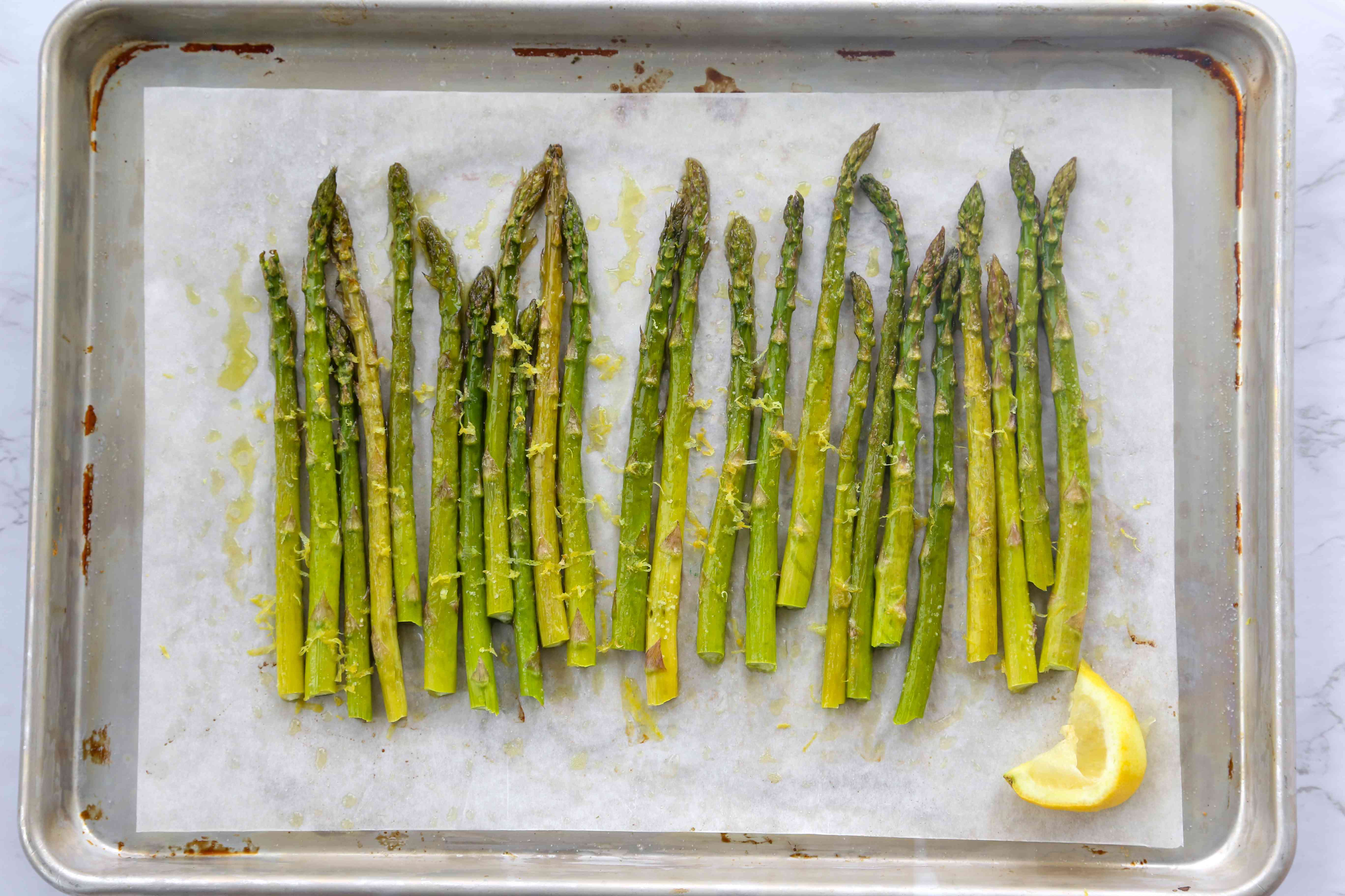 Easy Roasted Asparagus with lemon on a baking sheet